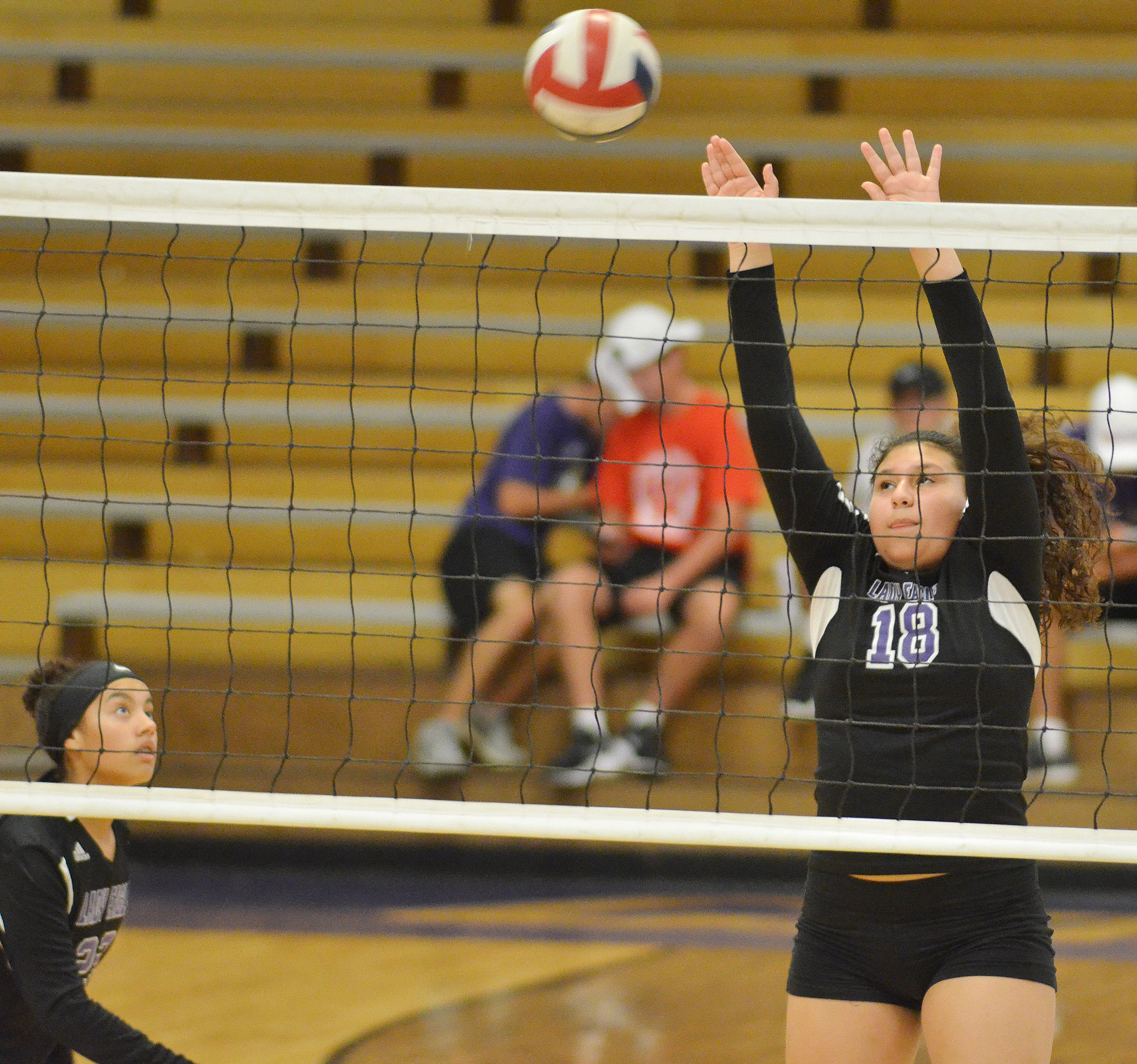 CHS freshman Anna Clara Moura blocks the ball.