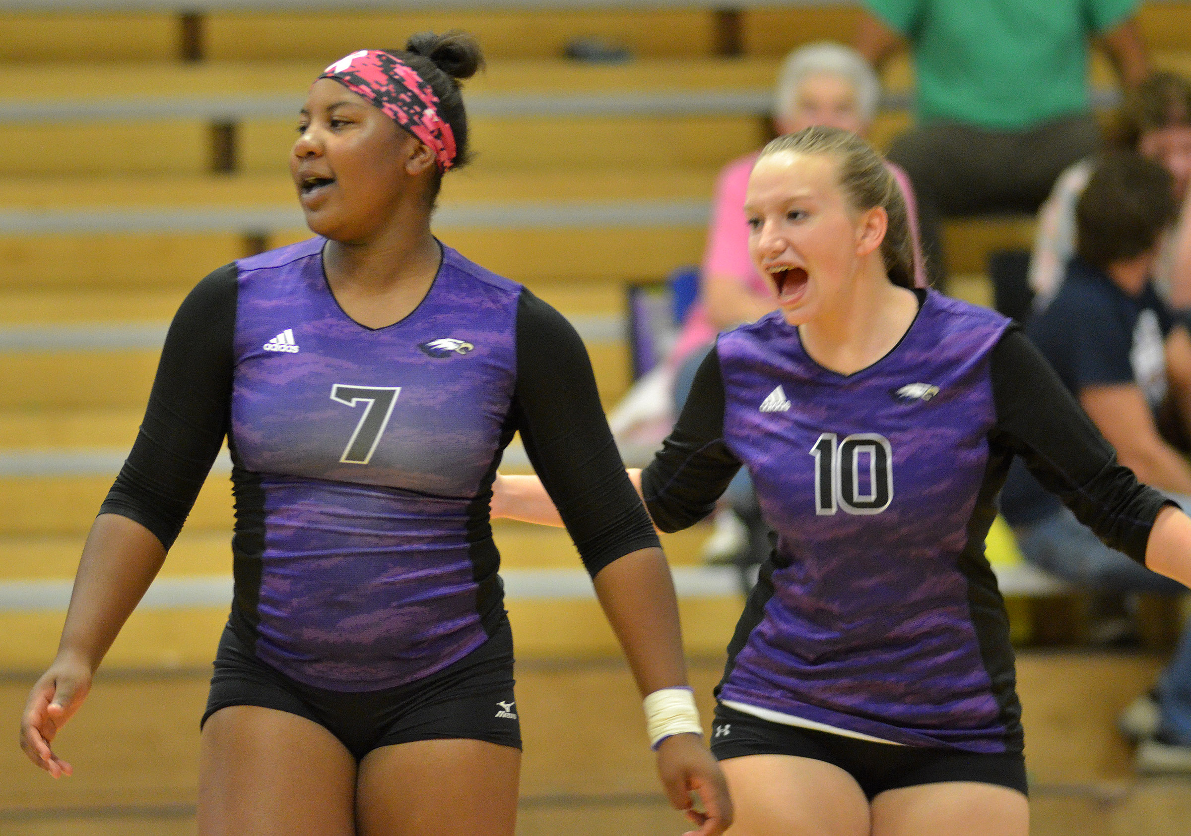 CHS seniors Kiyah Barnett, at left, and Madison Dial cheer after a point.