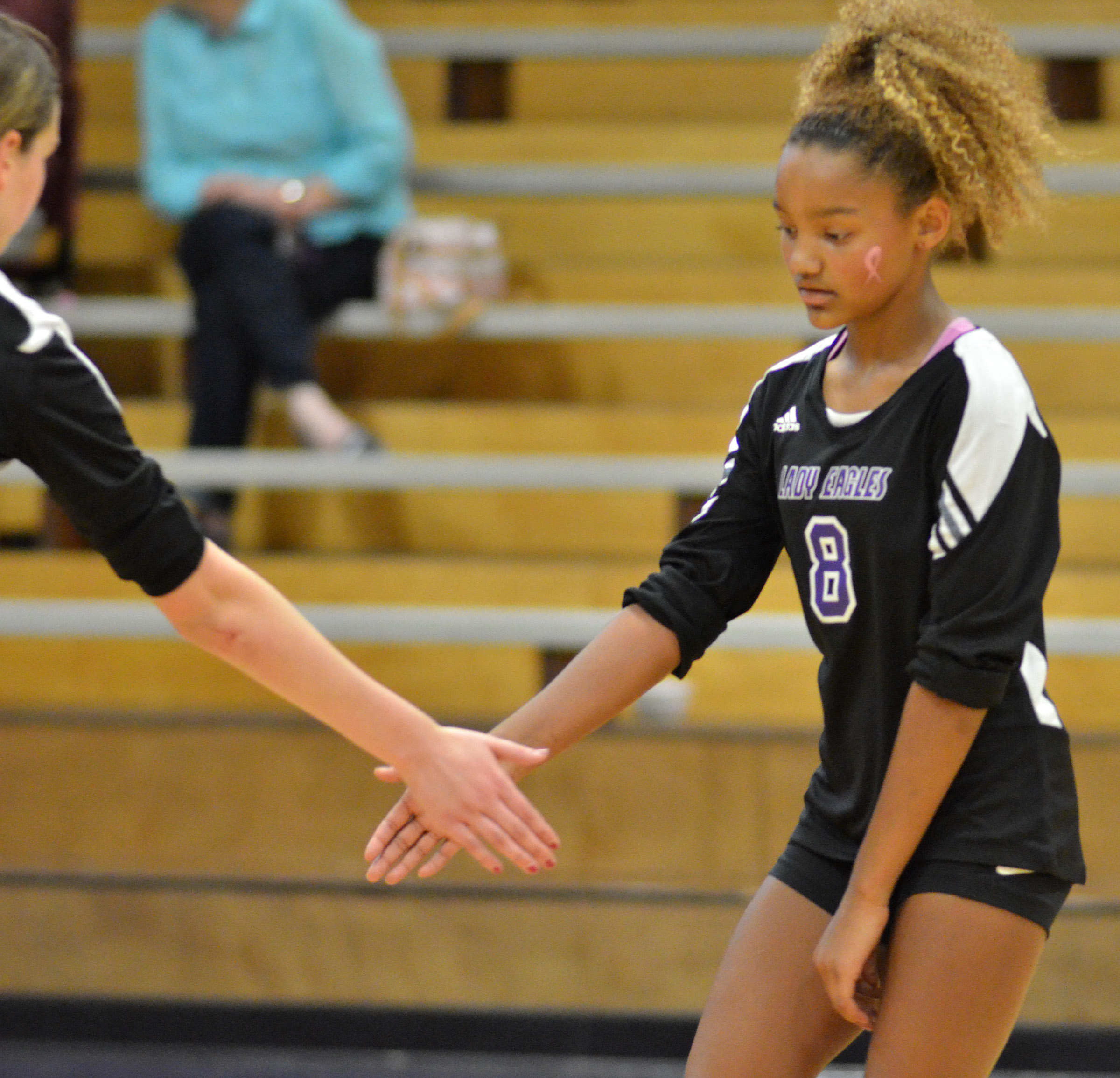 Campbellsville Middle School eighth-grader Alexis Thomas high-fives a teammate.