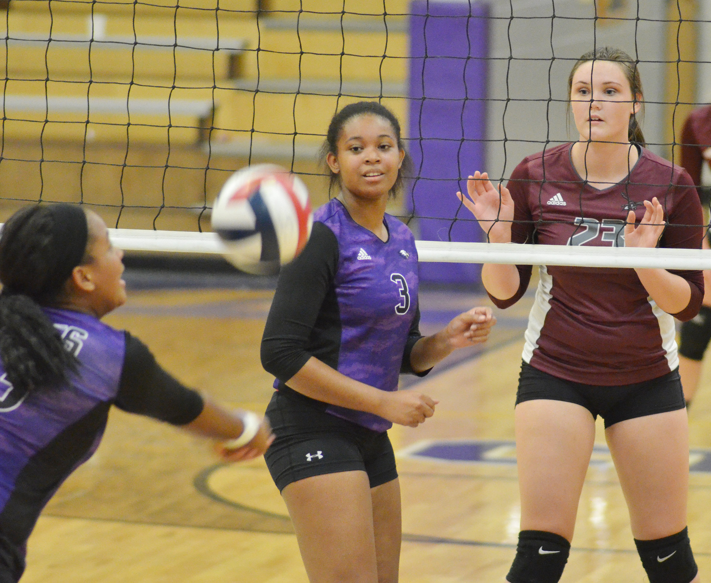 CHS senior Vonnea Smith watches as classmate Kayla Young hits the ball.