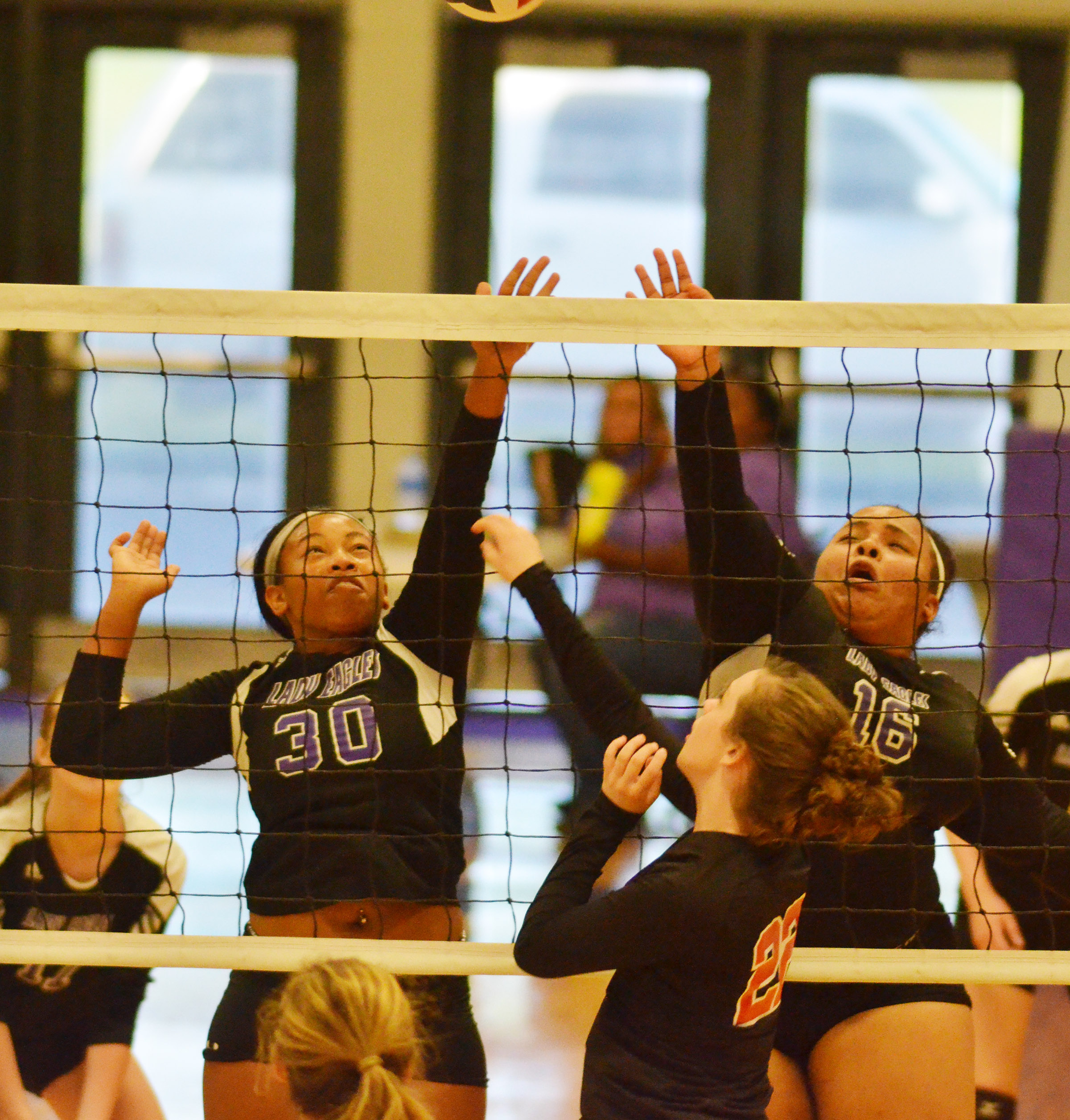 CHS sophomore Ketayah Taylor, at left, and junior Natalie Caldwell jump to block the ball.