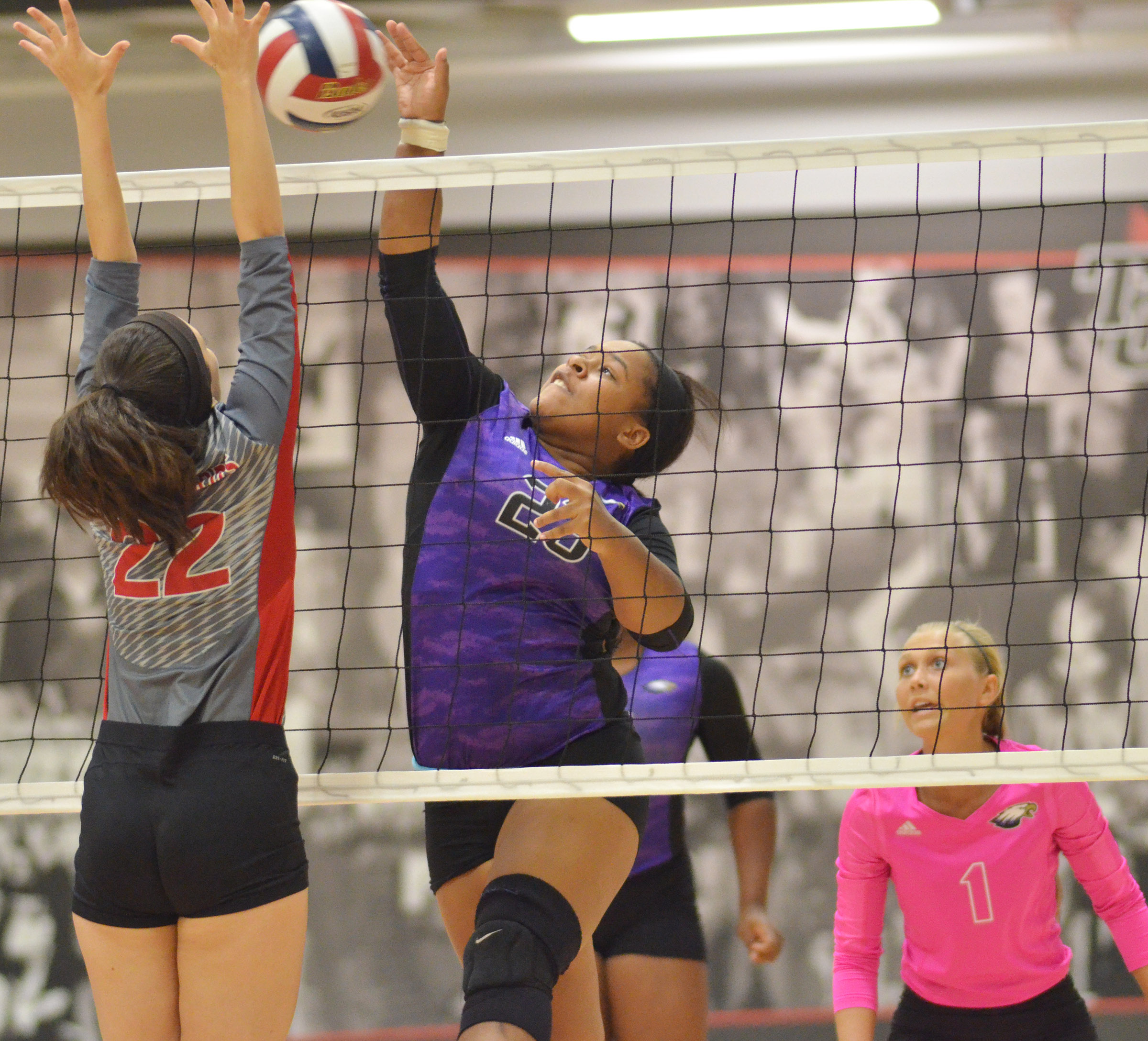 CHS senior Kayla Young hits the ball over the net.