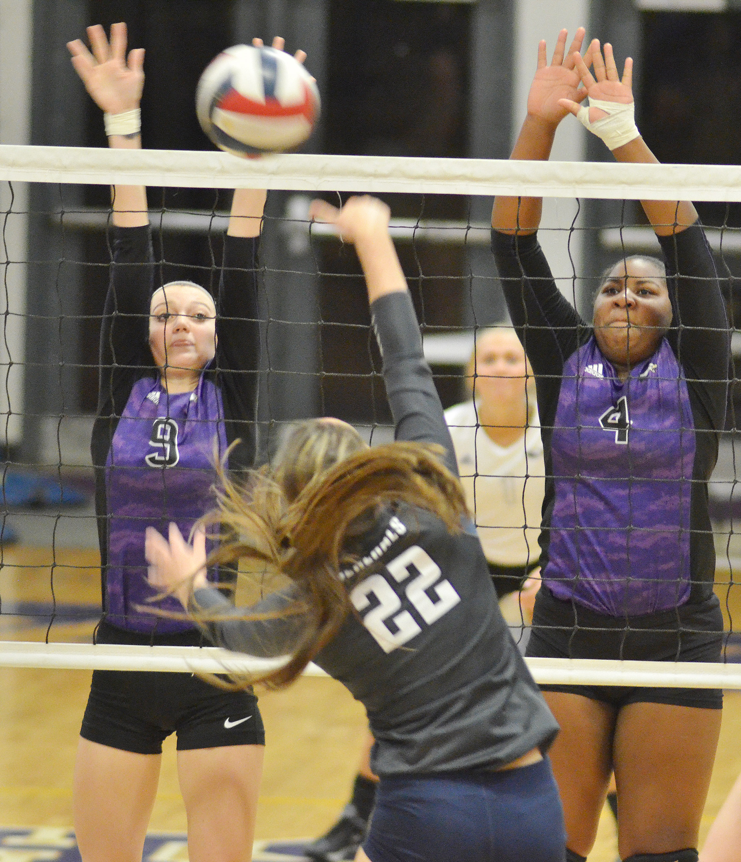 CHS junior Salena Ritchie, at left, and senior Nena Barnett block a shot at the net.