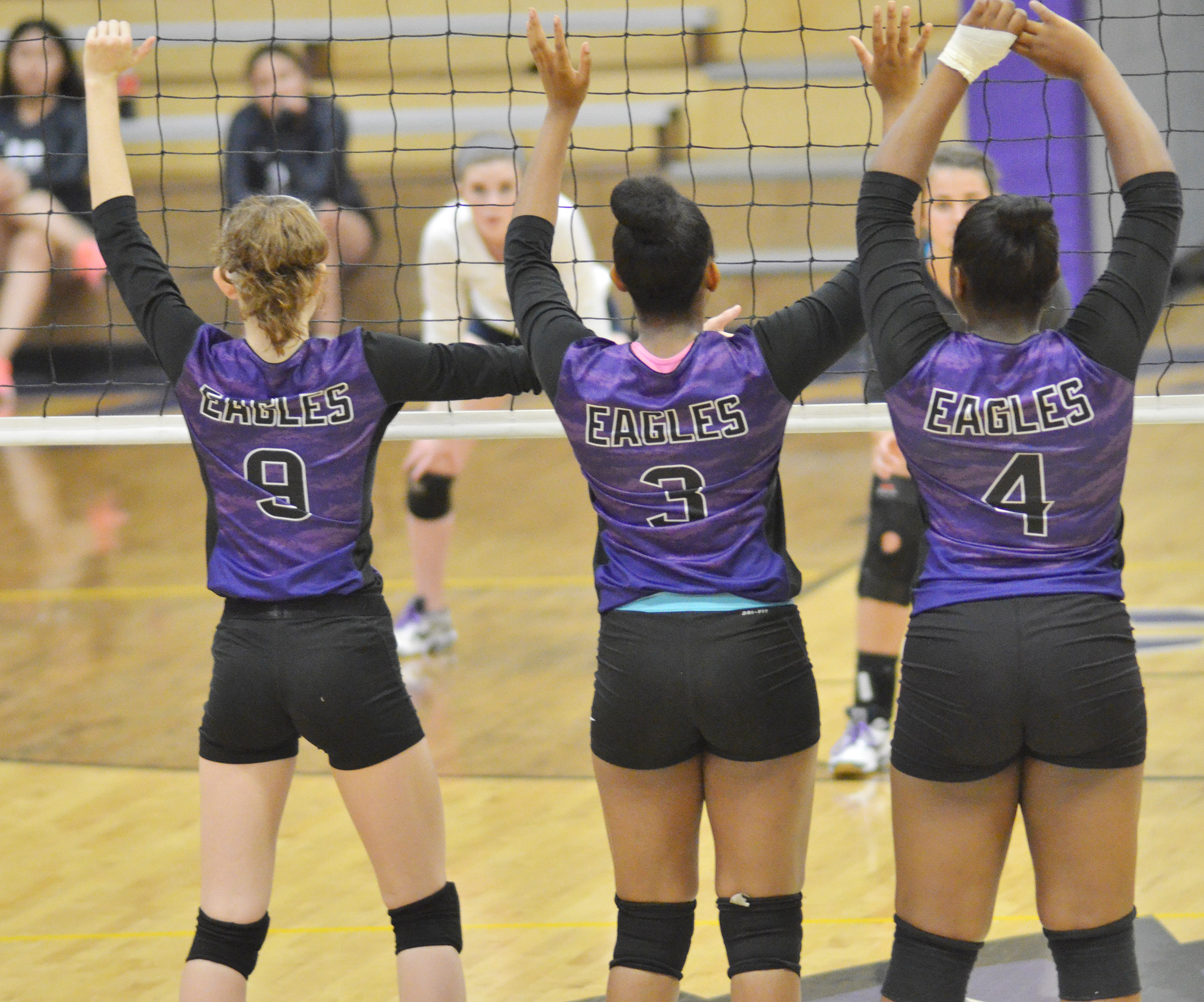 From left, CHS junior Salena Ritchie and seniors Vonnea Smith and Nena Barnett guard the net.