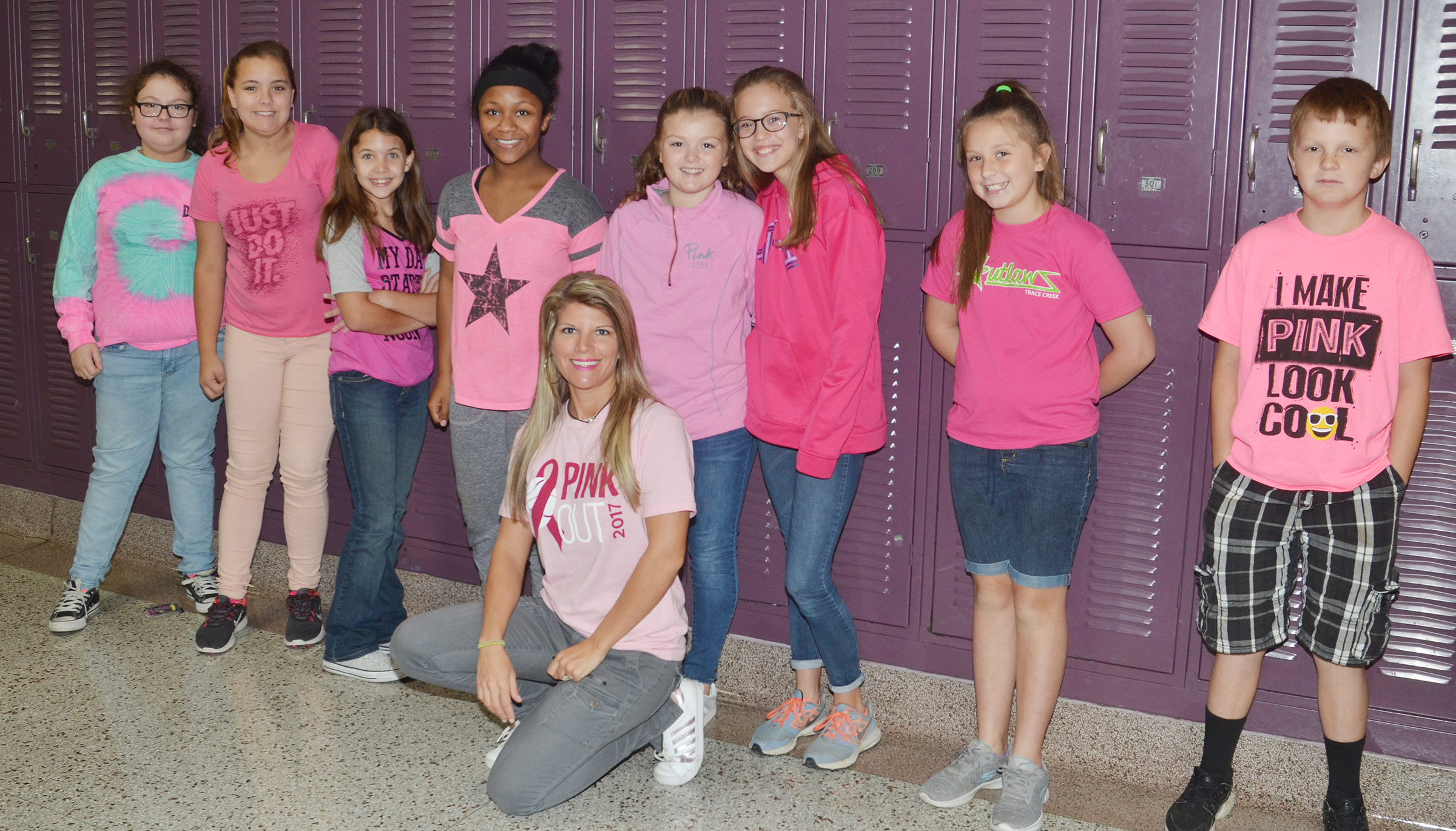 CMS students and teachers dress for the pink out.