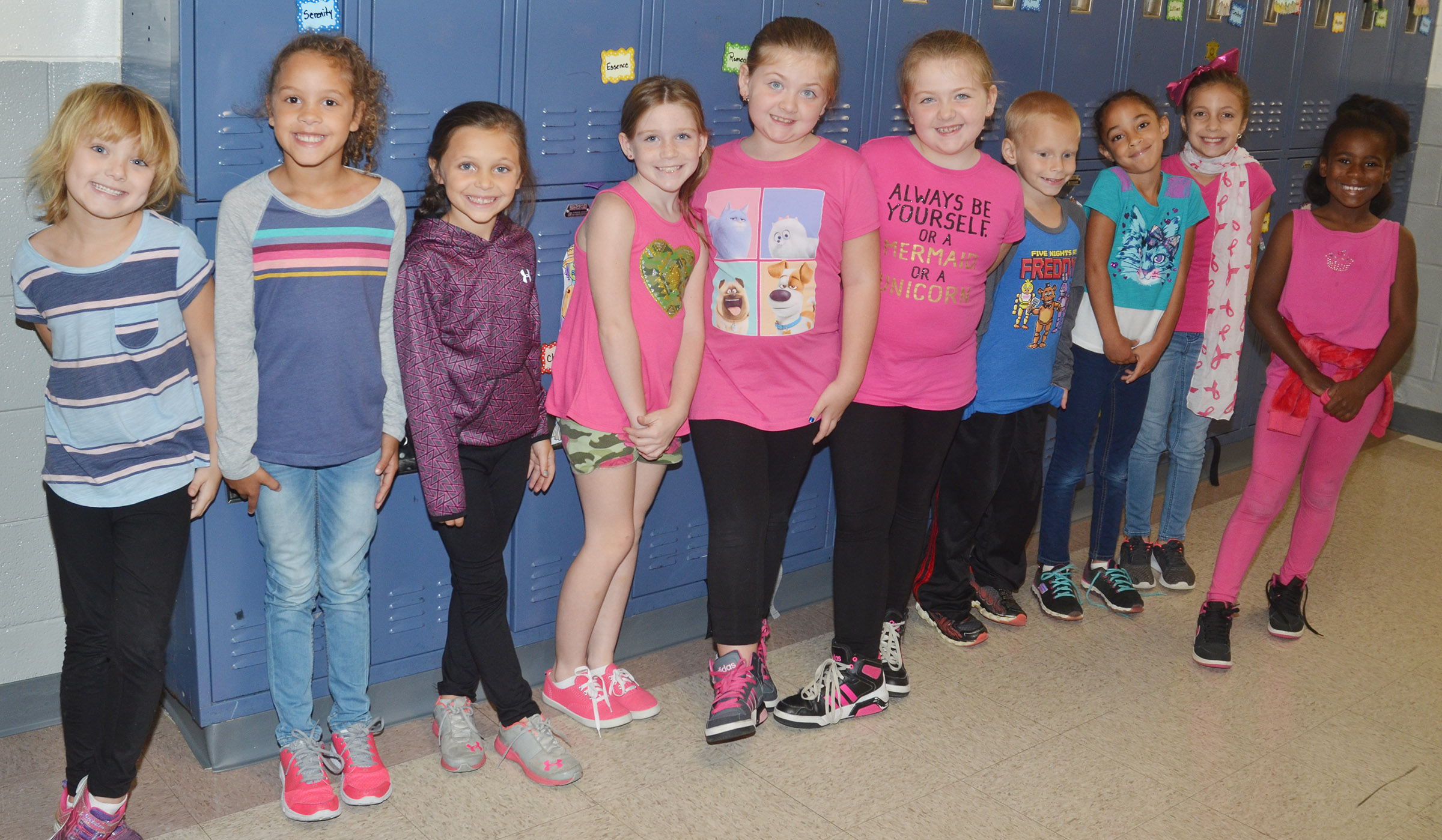 CES students and teachers dress for the pink out.