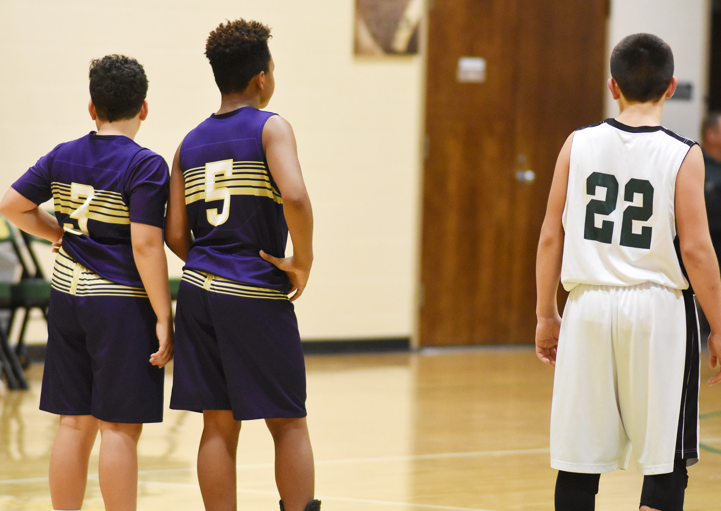CMS seventh-graders Kaydon Taylor, at left, and Deondre Weathers watch a foul shot.