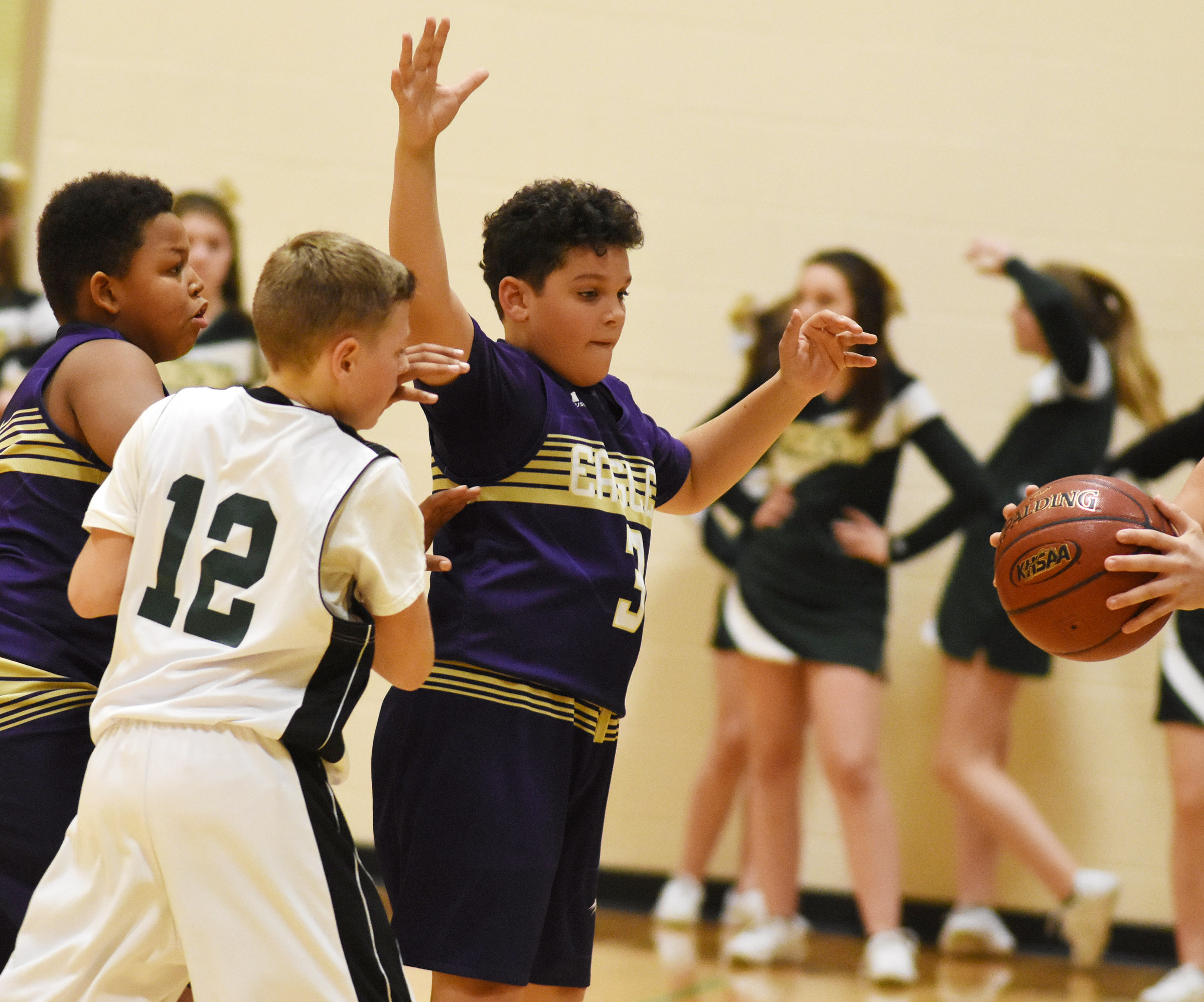 CMS seventh-graders Keondre Weathers, at left, and Kaydon Taylor battle for the ball.