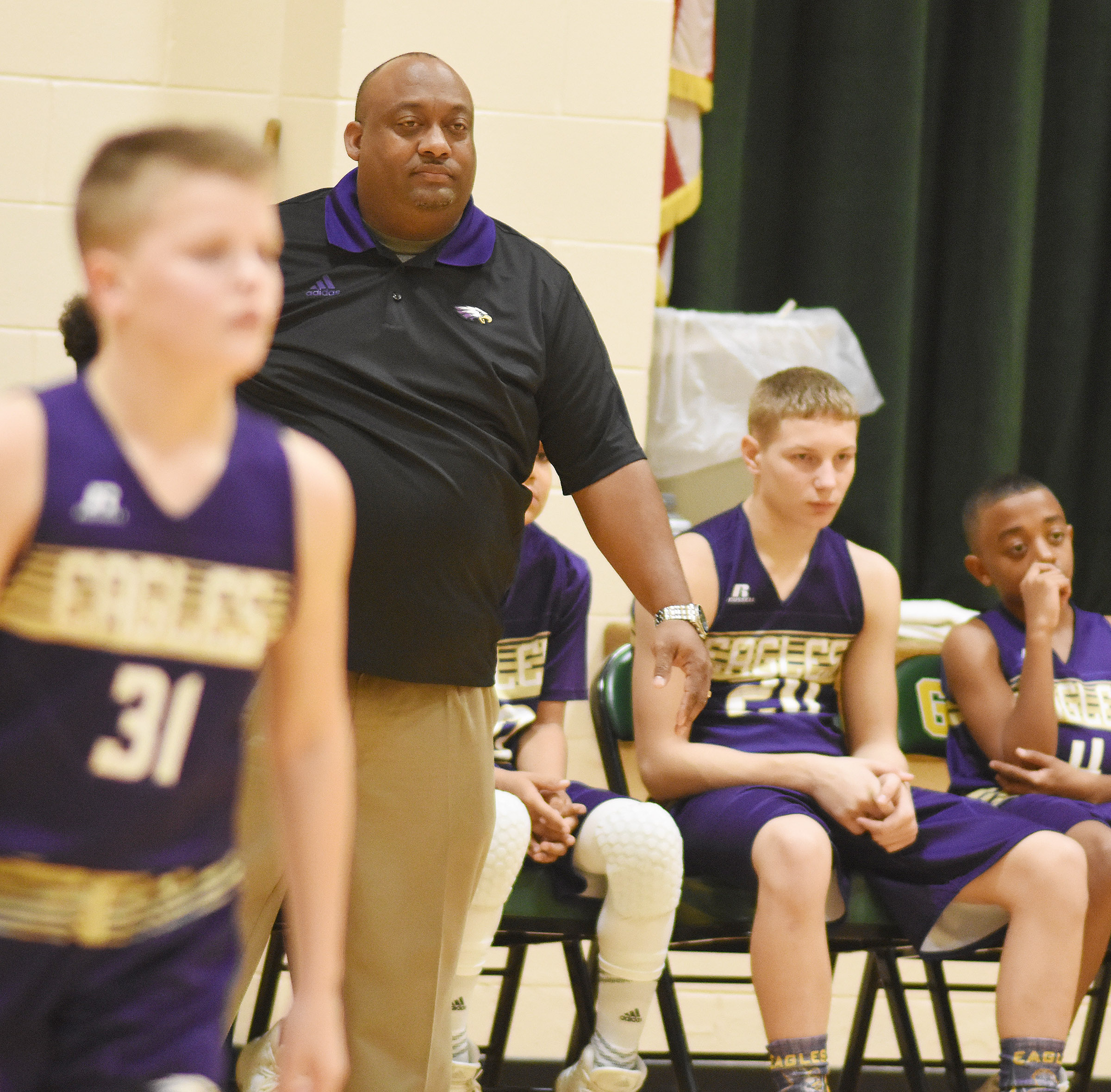 CMS boys' basketball coach Joseph Taylor watches his players.