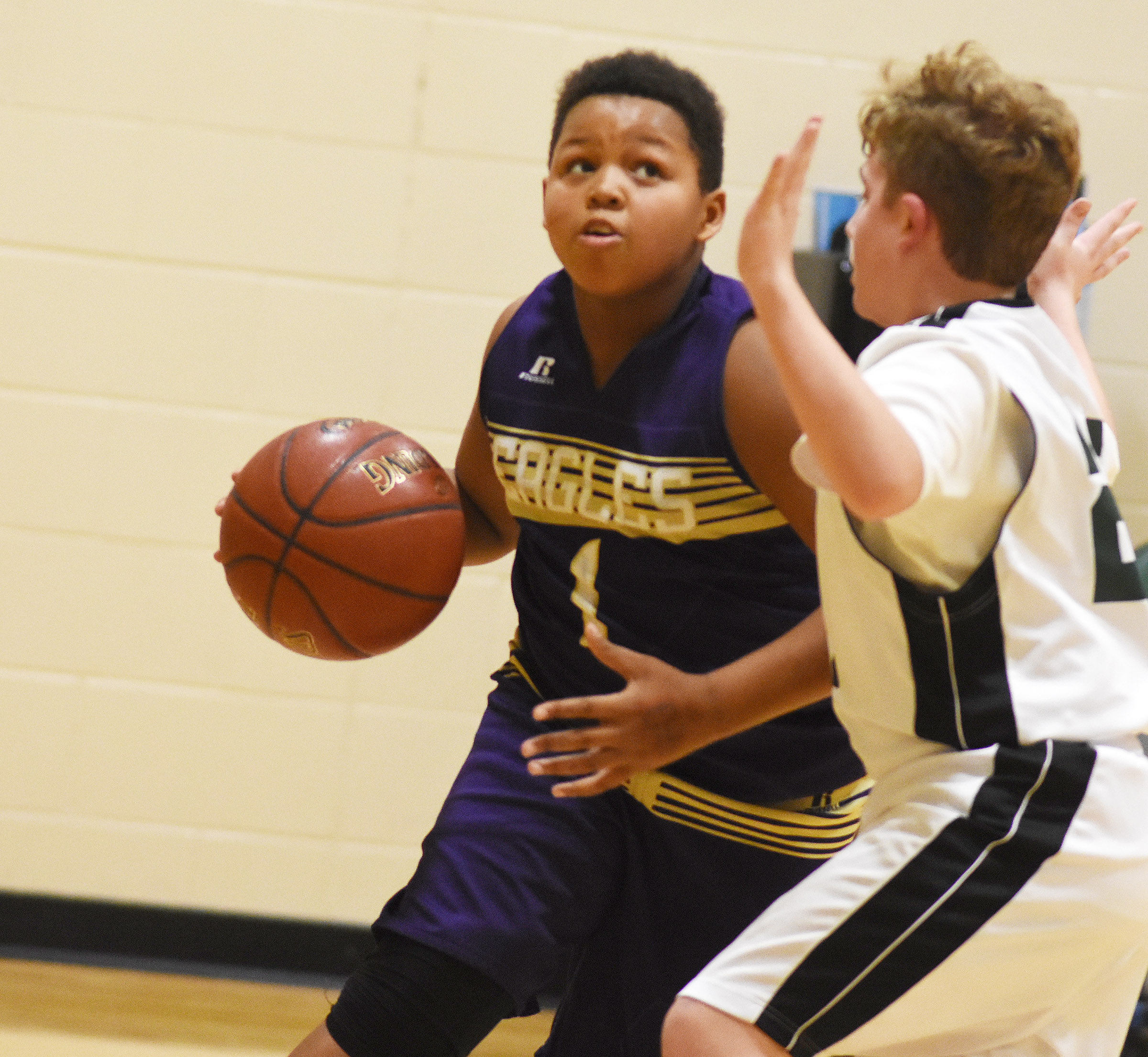 CMS seventh-grader Keondre Weathers drives the ball to the basket.