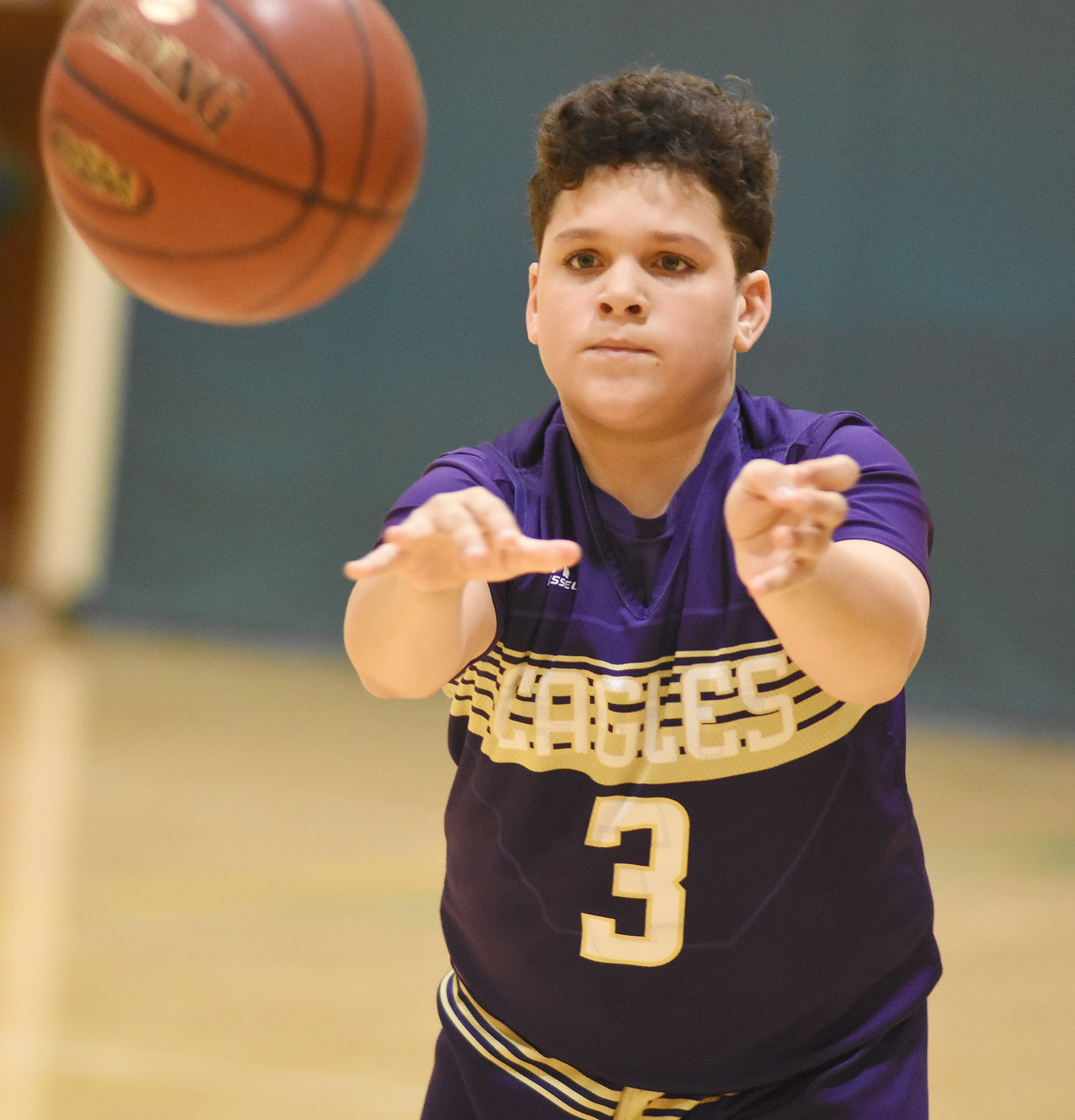 CMS seventh-grader Kaydon Taylor passes.