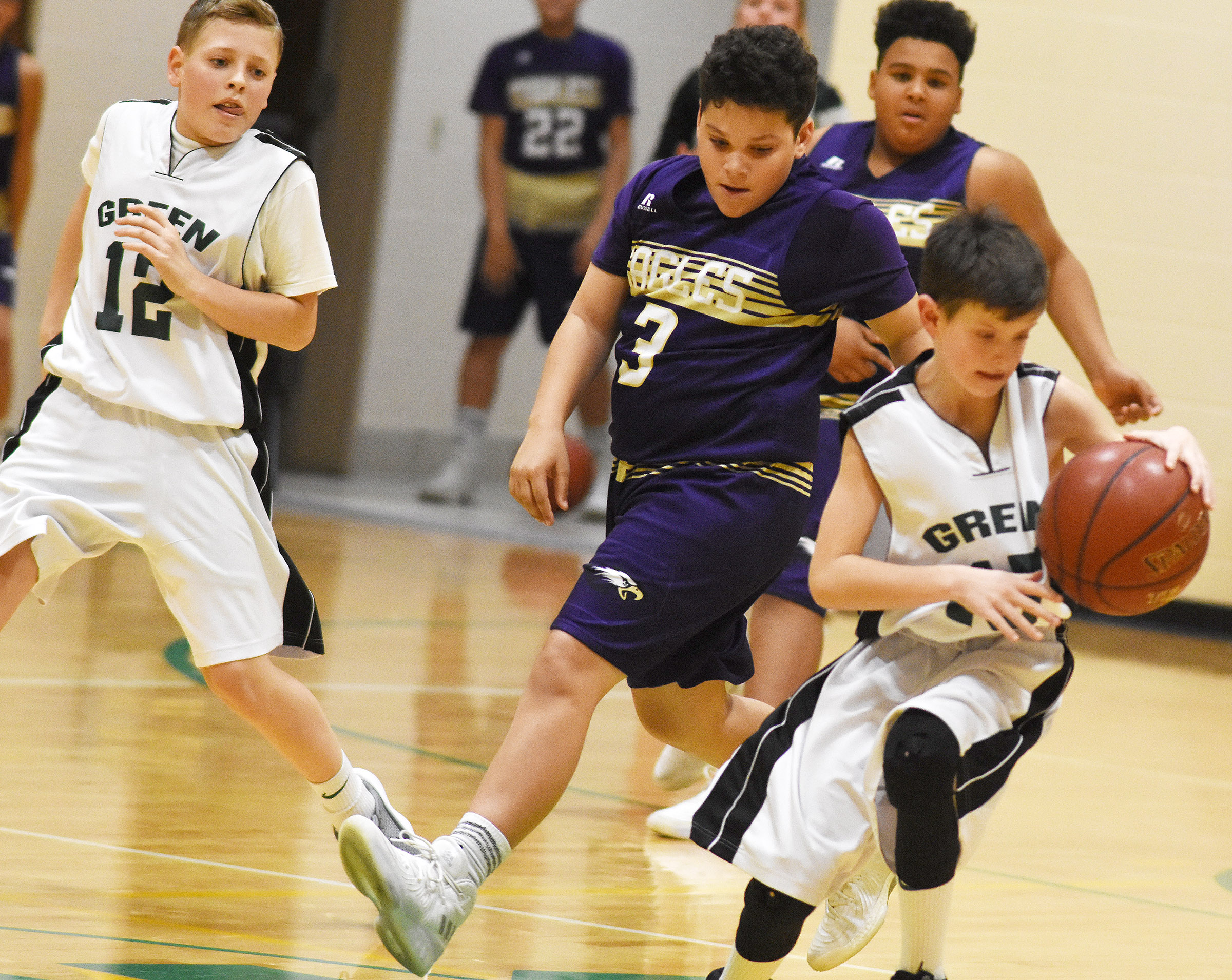 CMS seventh-grader Kaydon Taylor fights for the ball.