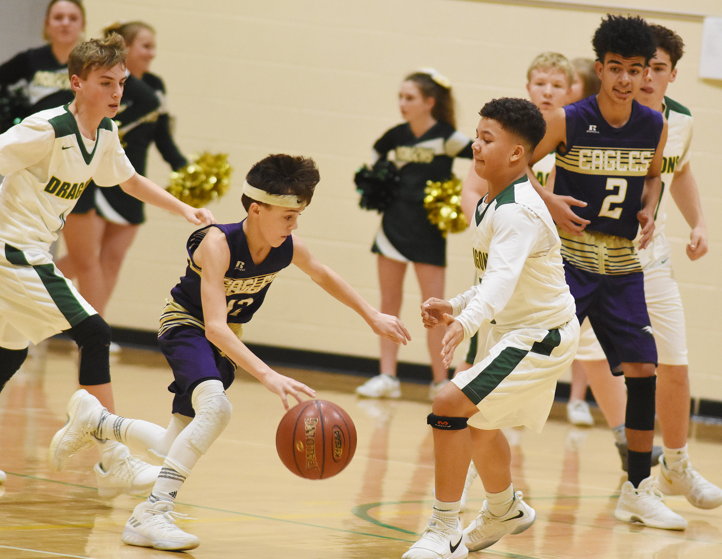 CMS seventh-grader Chase Hord drives the ball as eighth-grader Adrien Smith blocks.
