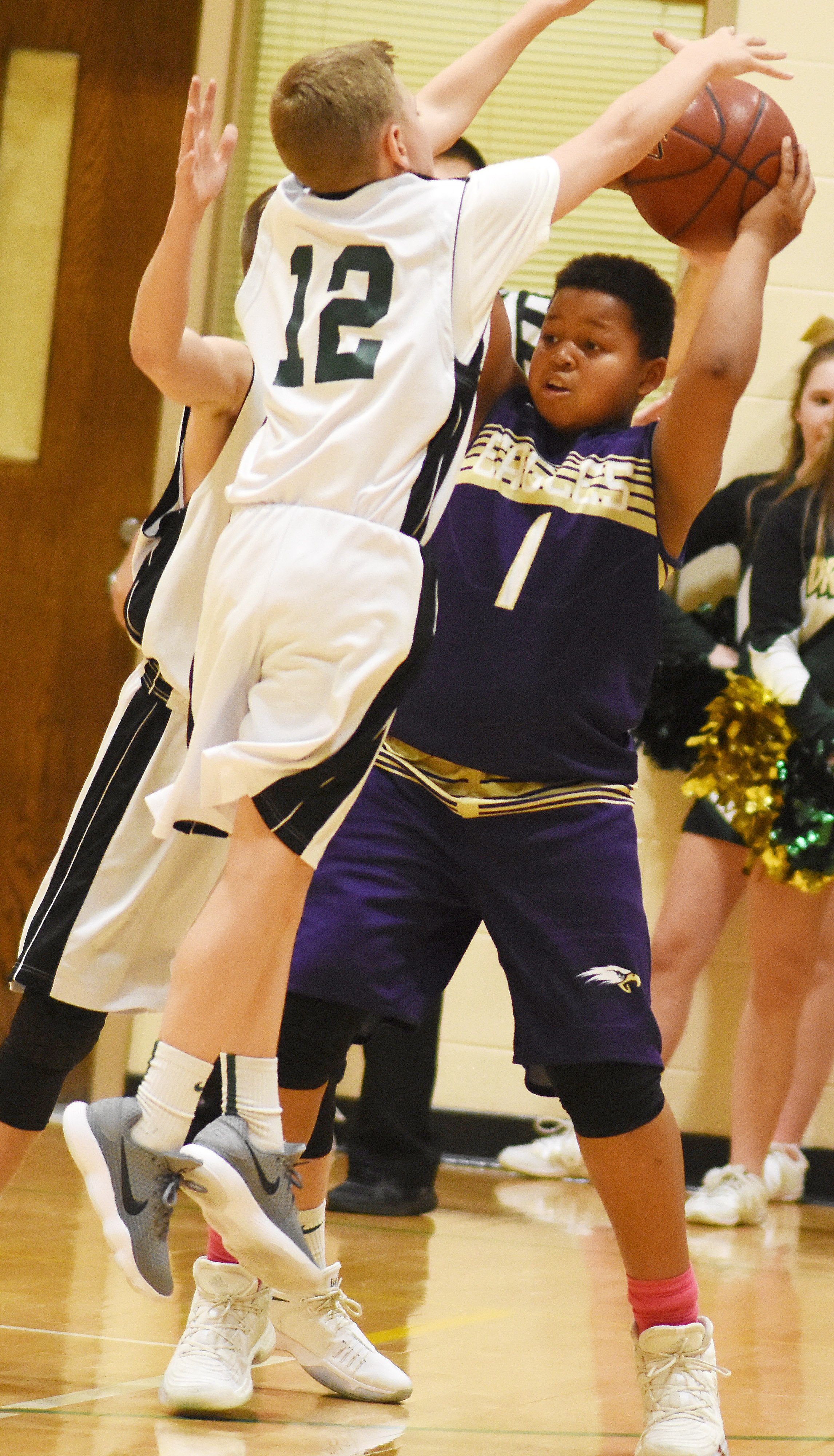 CMS seventh-grader Keondre Weathers protects the ball.