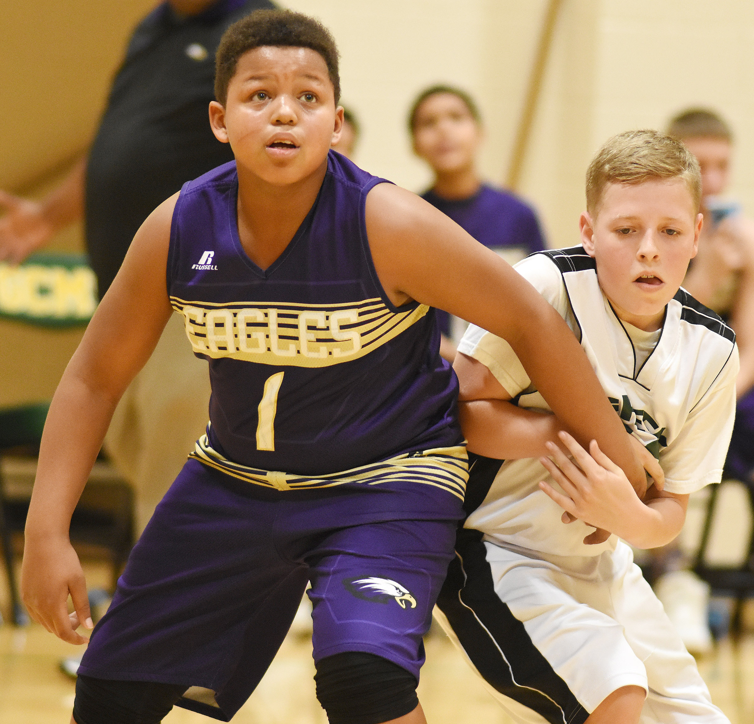 CMS seventh-grader Keondre Weathers looks for a rebound.