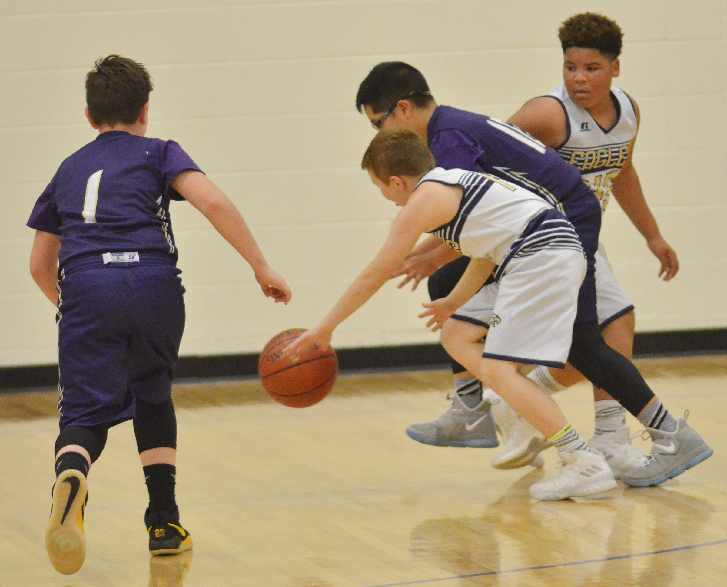 "CMS sixth-graders Jason ""Junior"" Jeffries, at left, and Devin Kinser play defense."
