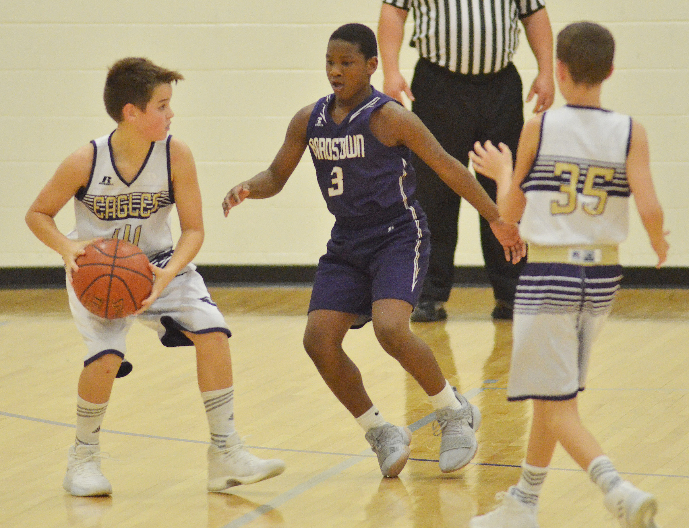 CMS sixth-grader Kaden Bloyd looks to pass.