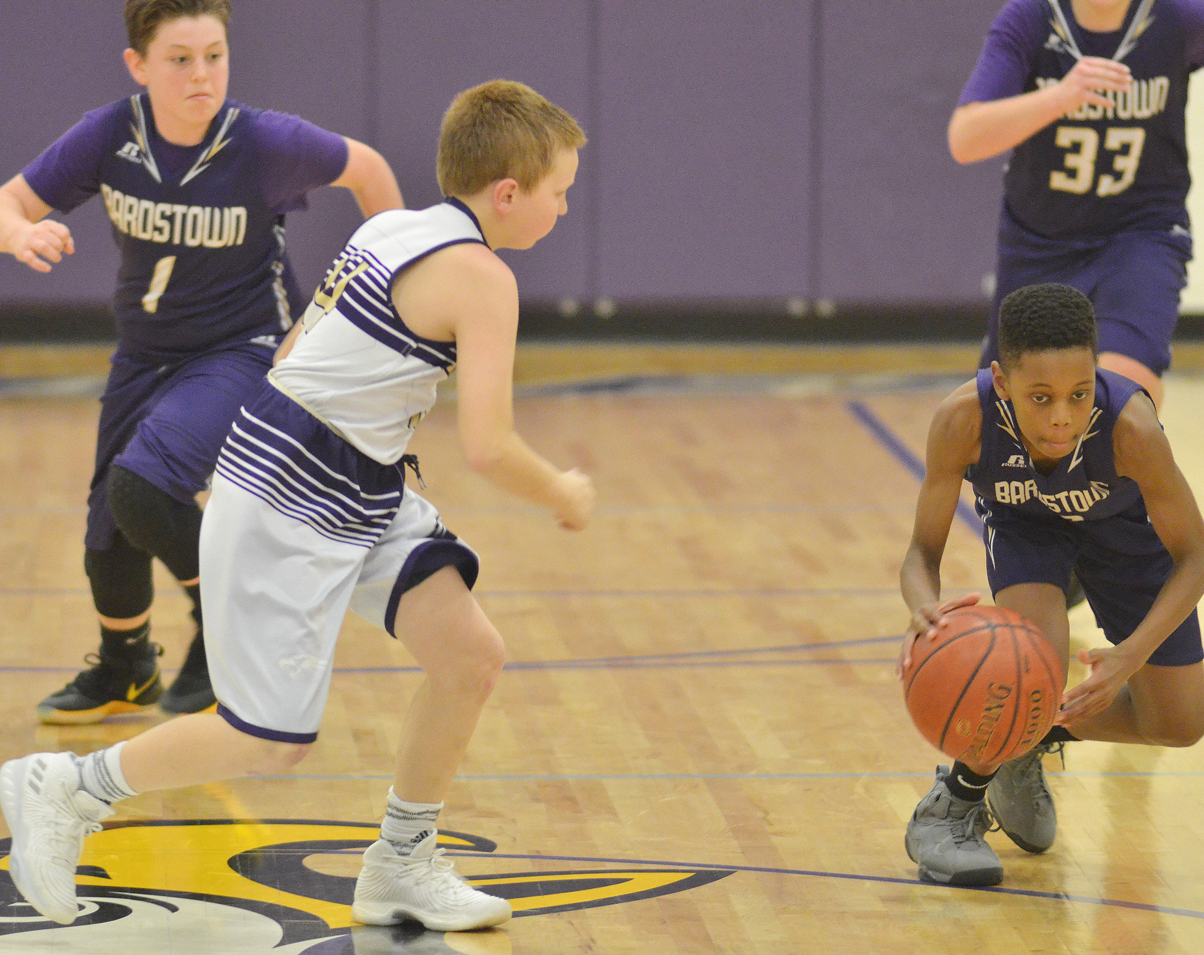 "CMS sixth-grader Jason ""Junior"" Jeffries goes after the ball."