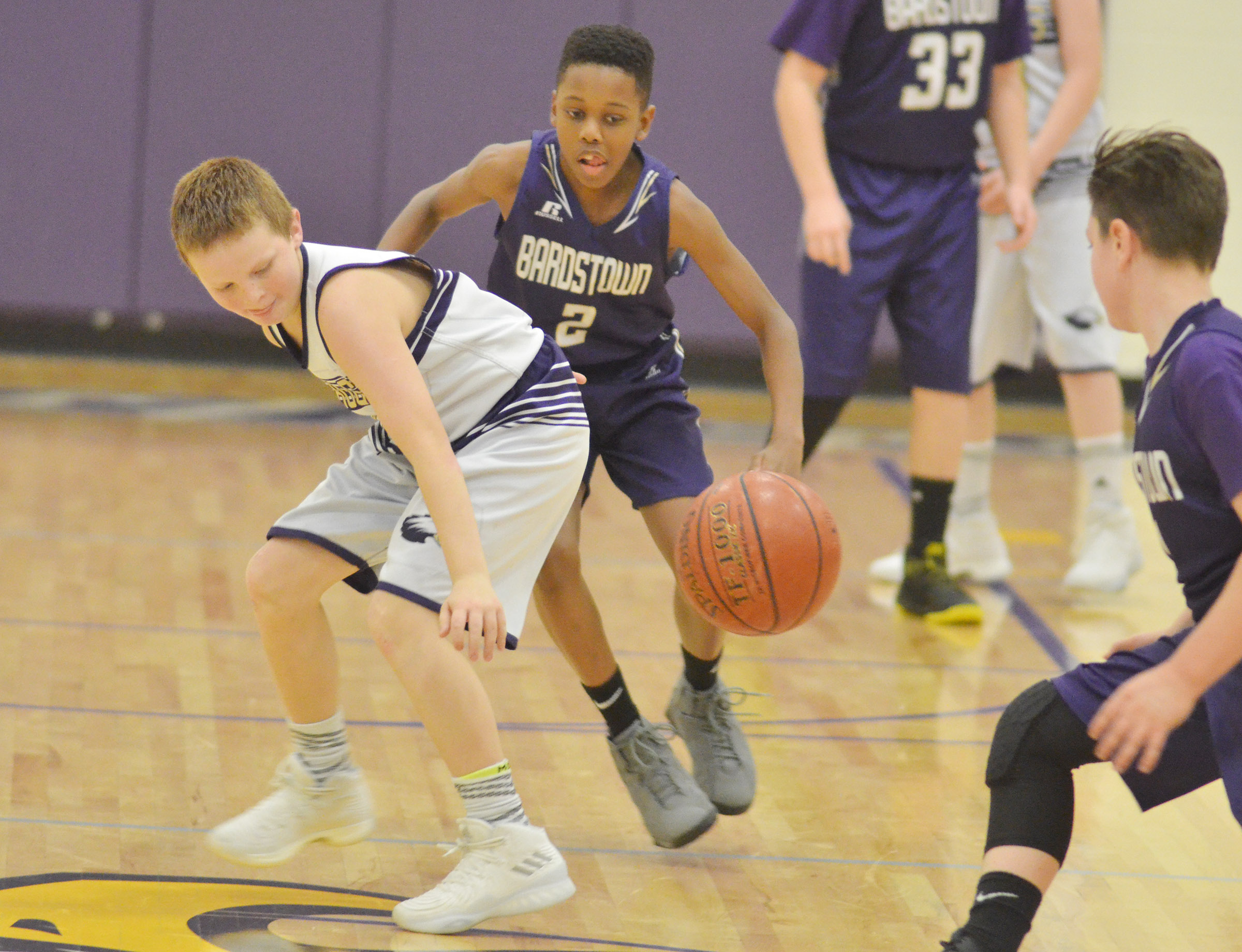 "CMS sixth-grader Jason ""Junior"" Jeffries fights for the ball."