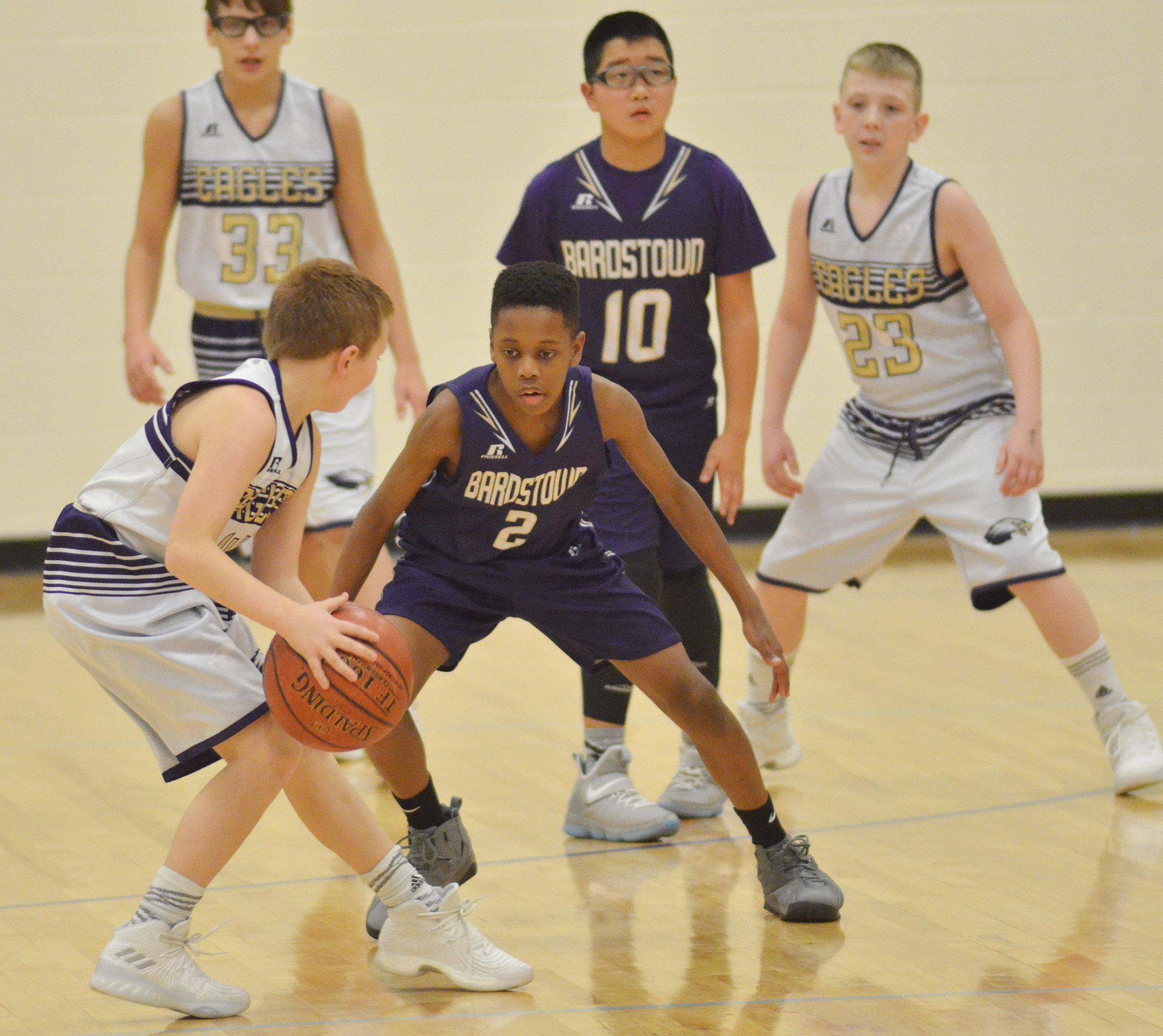 "CMS sixth-grader Jason ""Junior"" Jeffries protects the ball as his teammates, Campbellsville Elementary School fifth-graders Dalton Morris, at left, and Kaleb Miller play defense."