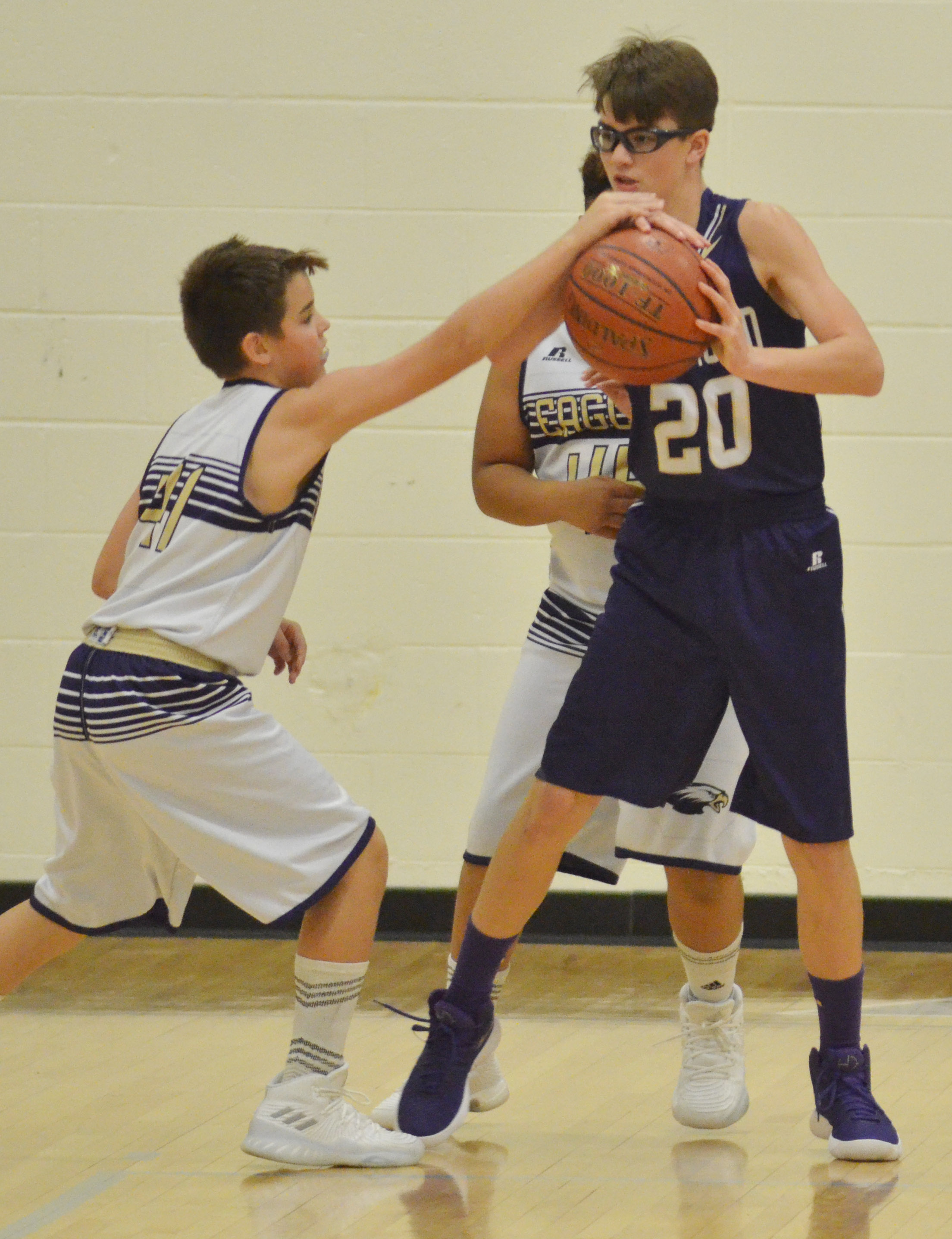 CMS sixth-grader Kaden Bloyd, at left, and Devin Kinser fight for the ball.