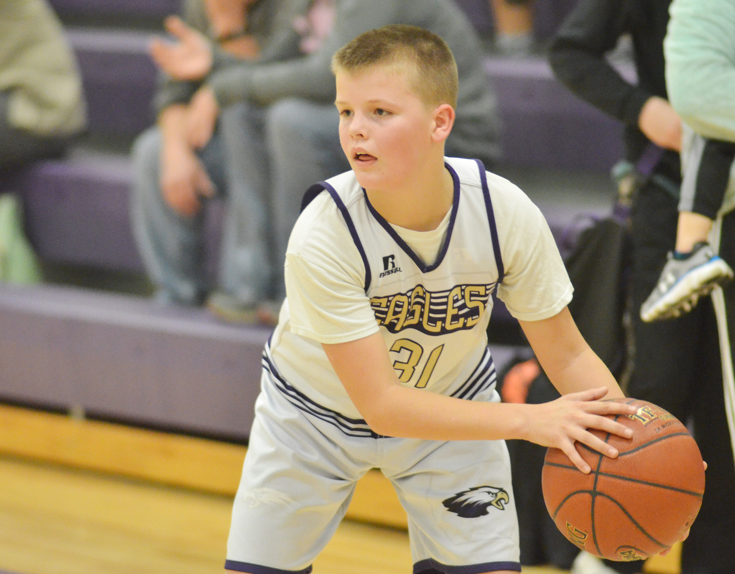 CMS seventh-grader Konner Forbis passes the ball.