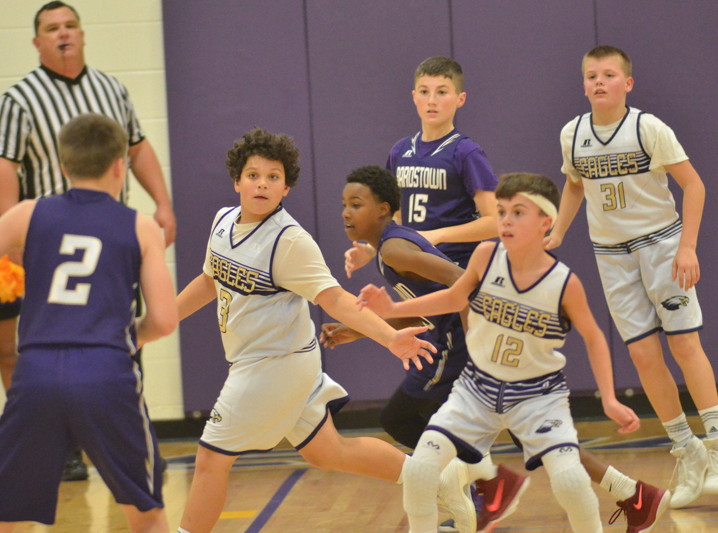 From left, CMS seventh-graders Kaydon Taylor, Chase Hord and Konner Forbis play defense.