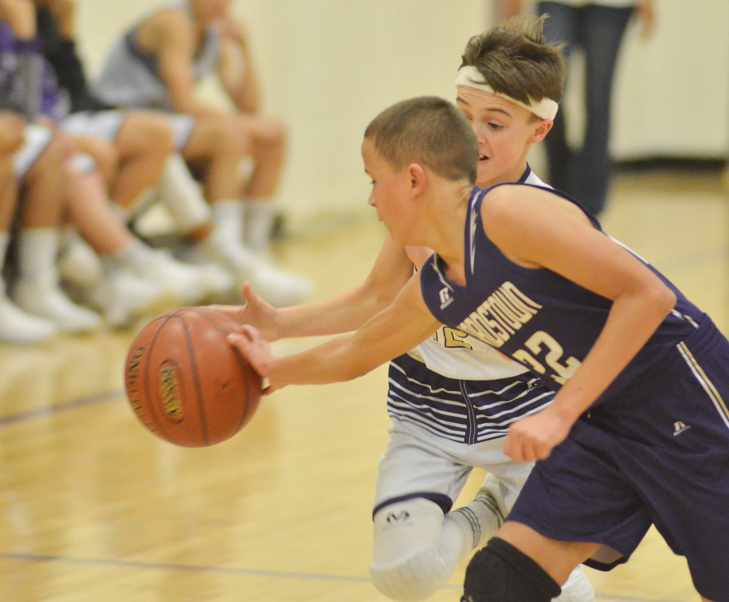 CMS seventh-grader Chase Hord fights for the ball.