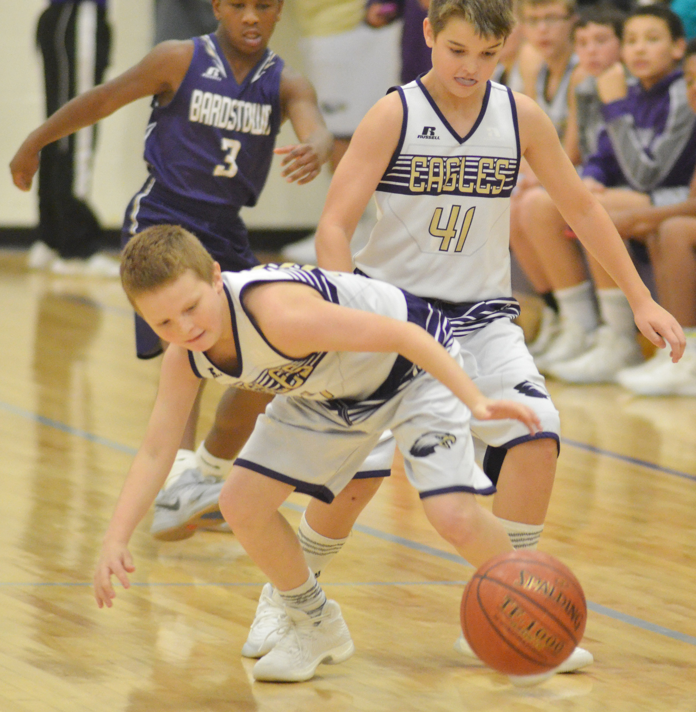 "CMS sixth-grader Jason ""Junior"" Jeffries, at left, and Kaden Bloyd fight for the ball."