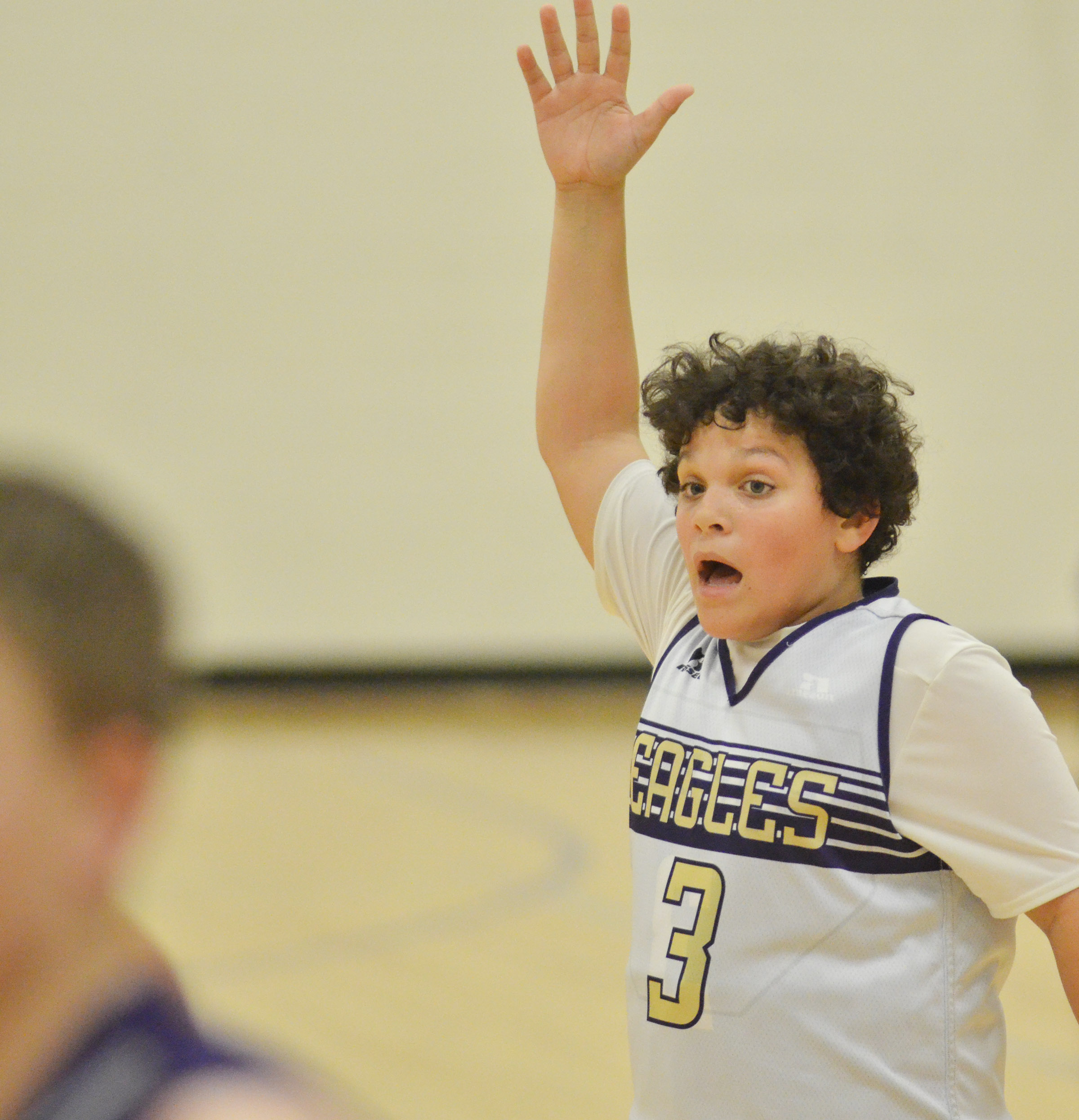 CMS seventh-grader Kaydon Taylor calls for the ball.