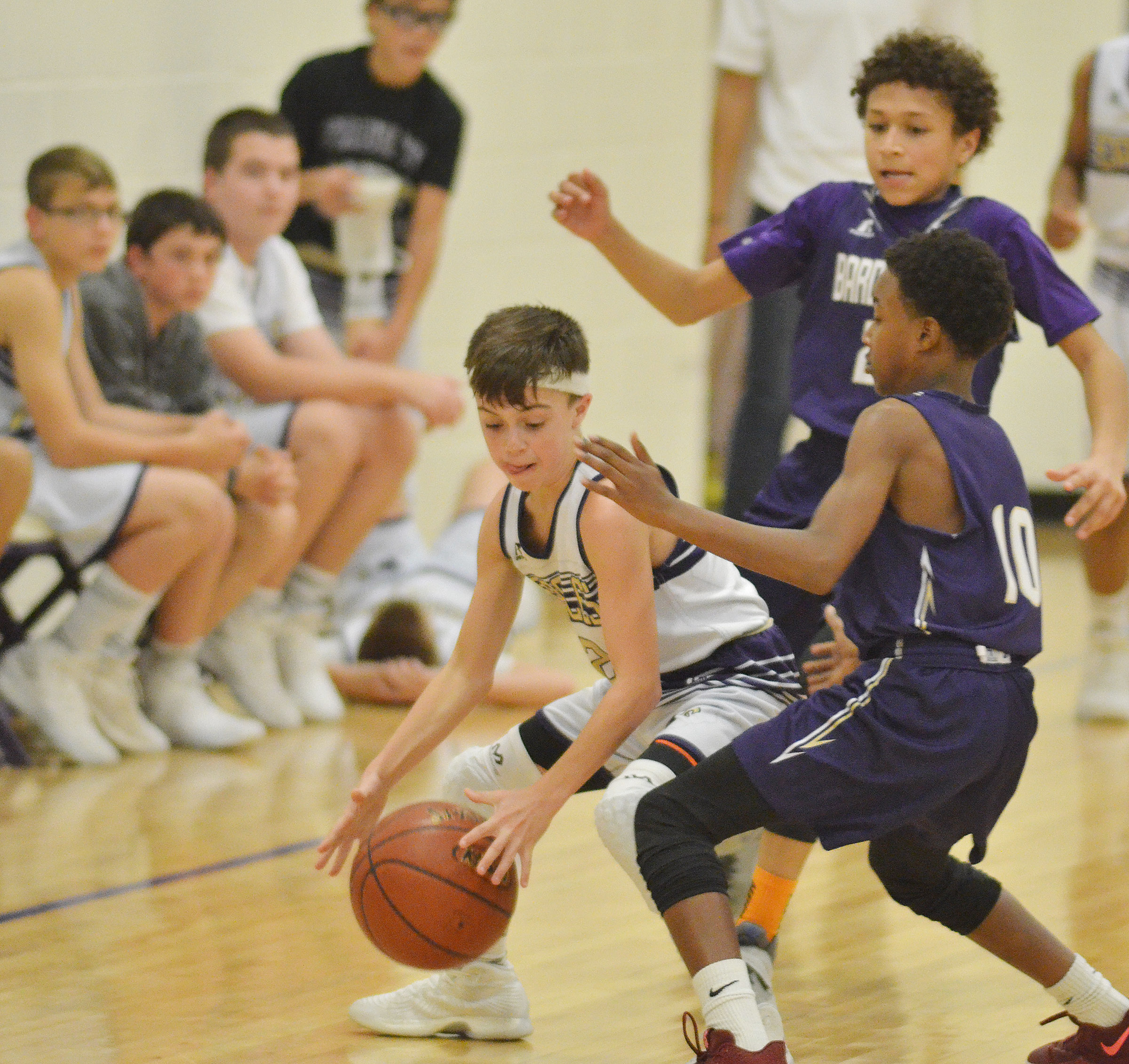 CMS seventh-grader Chase Hord protects the ball.
