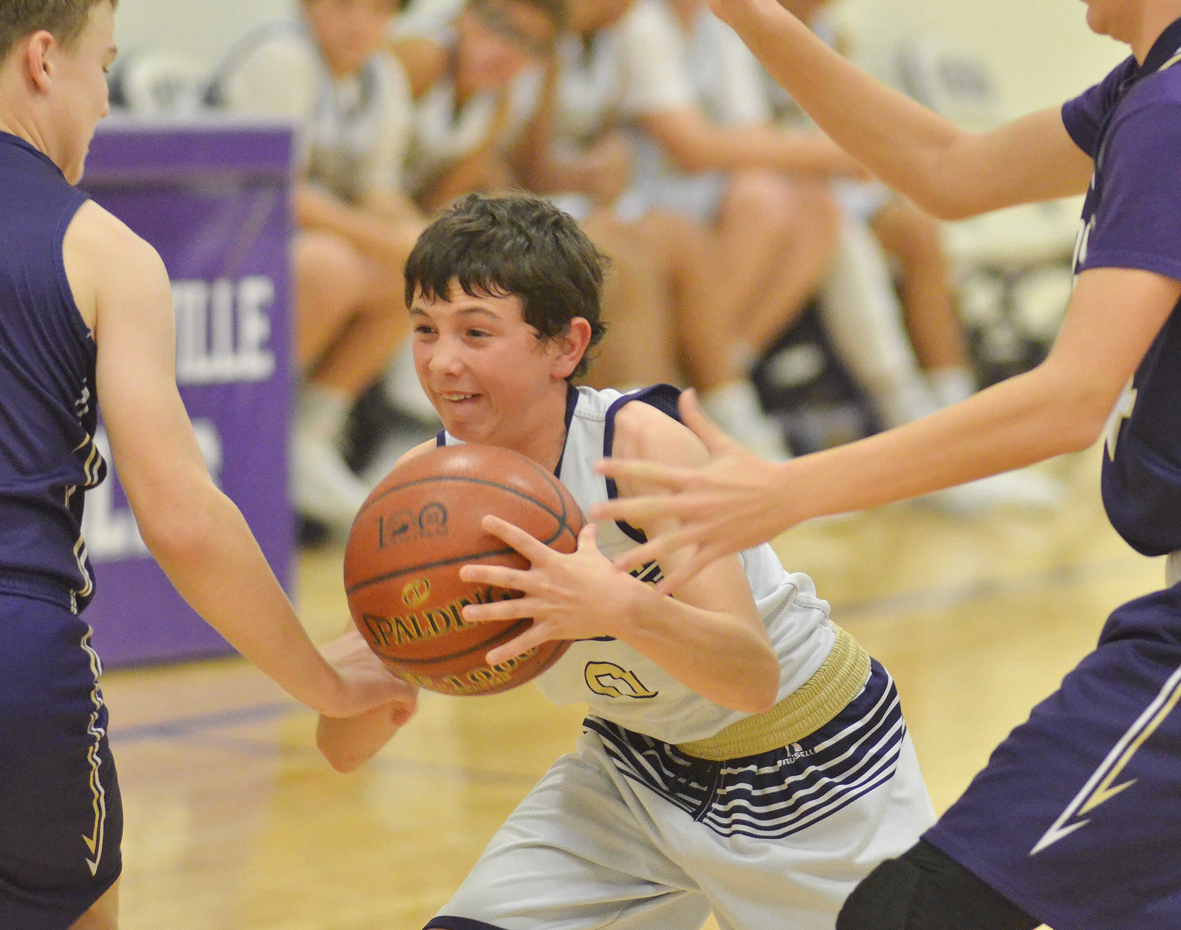 CMS eighth-grader Dakota Harris protects the ball.
