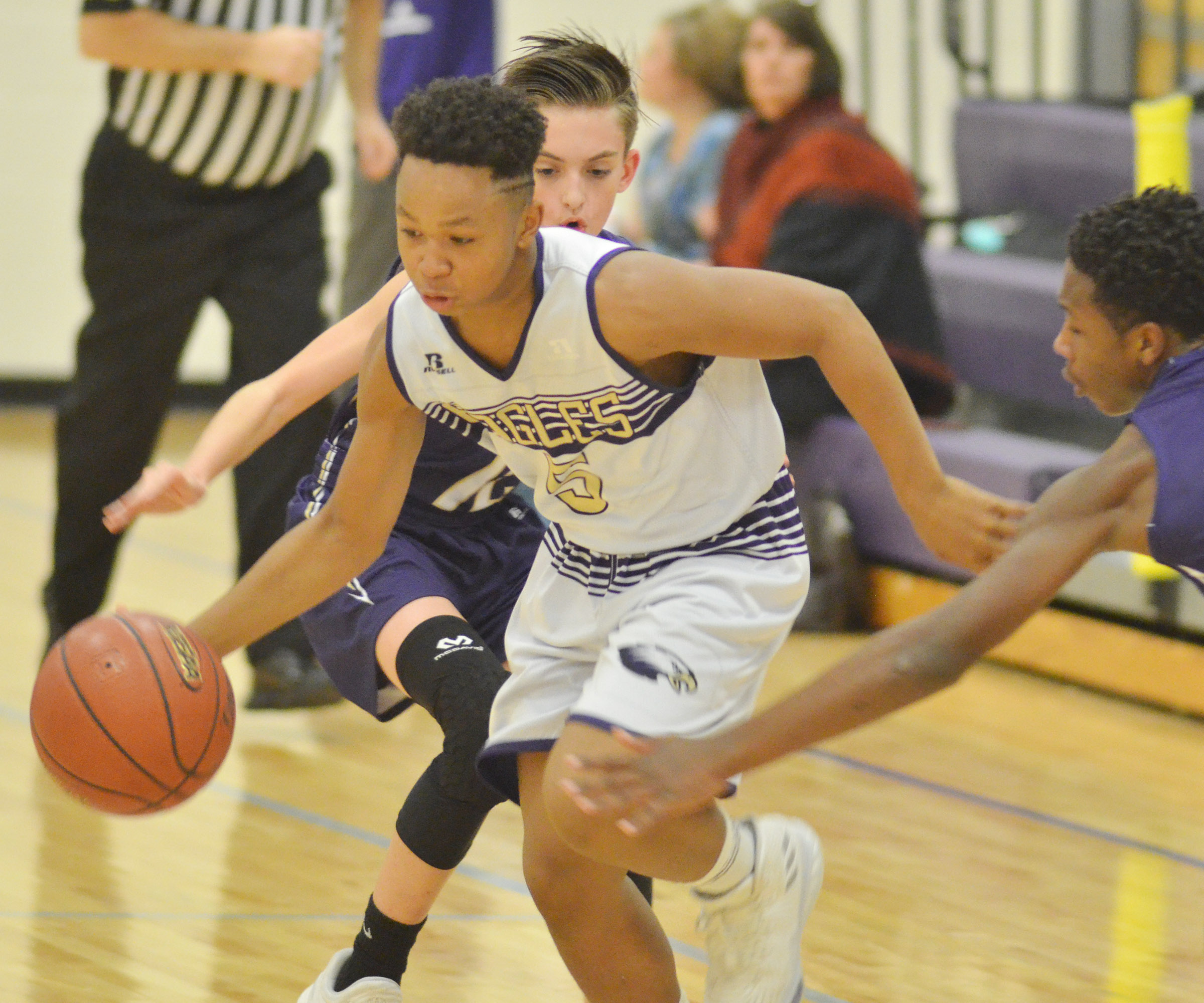 CMS seventh-grader Deondre Weathers dribbles to the hoop.