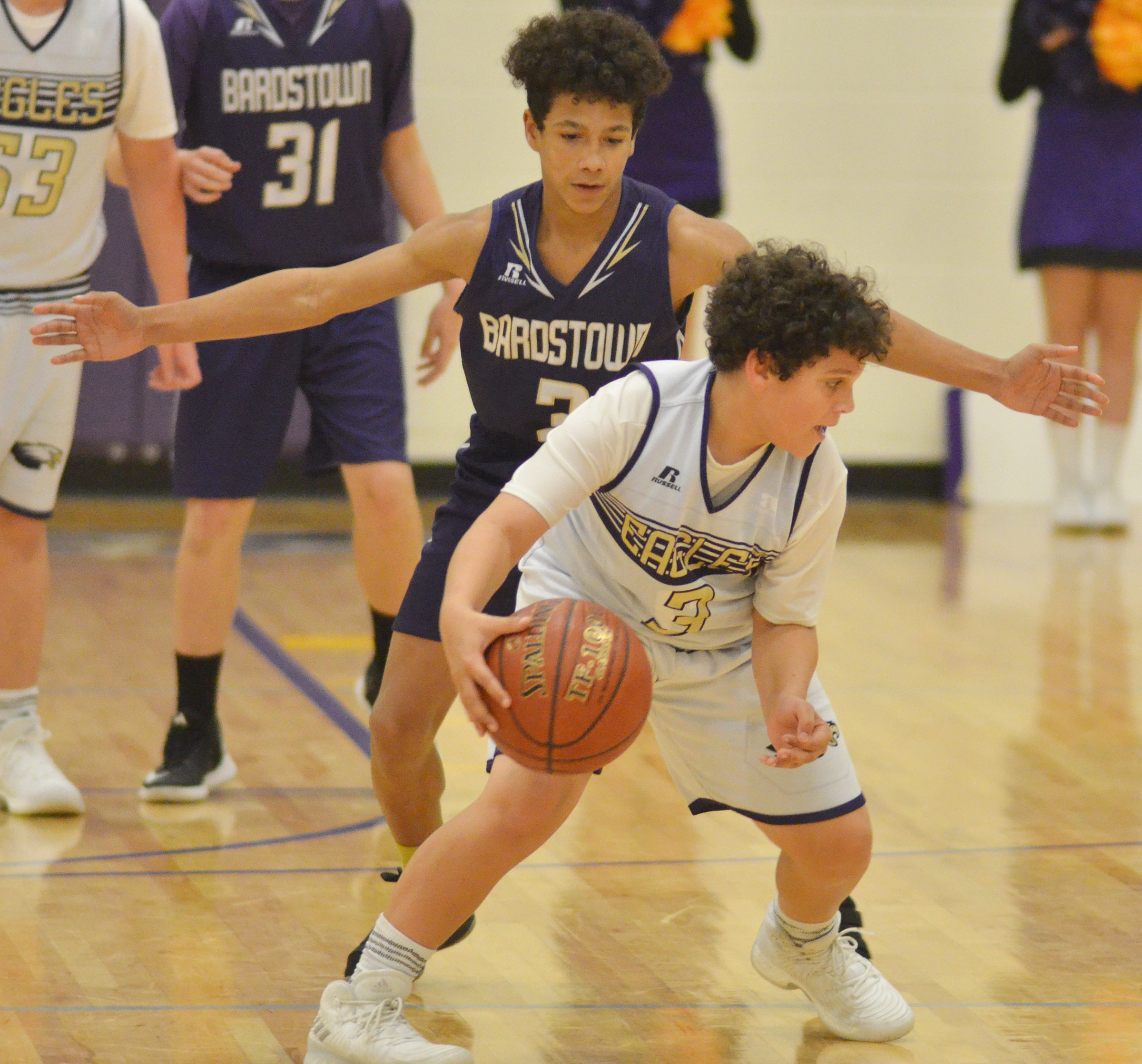 CMS seventh-grader Kaydon Taylor protects the ball.