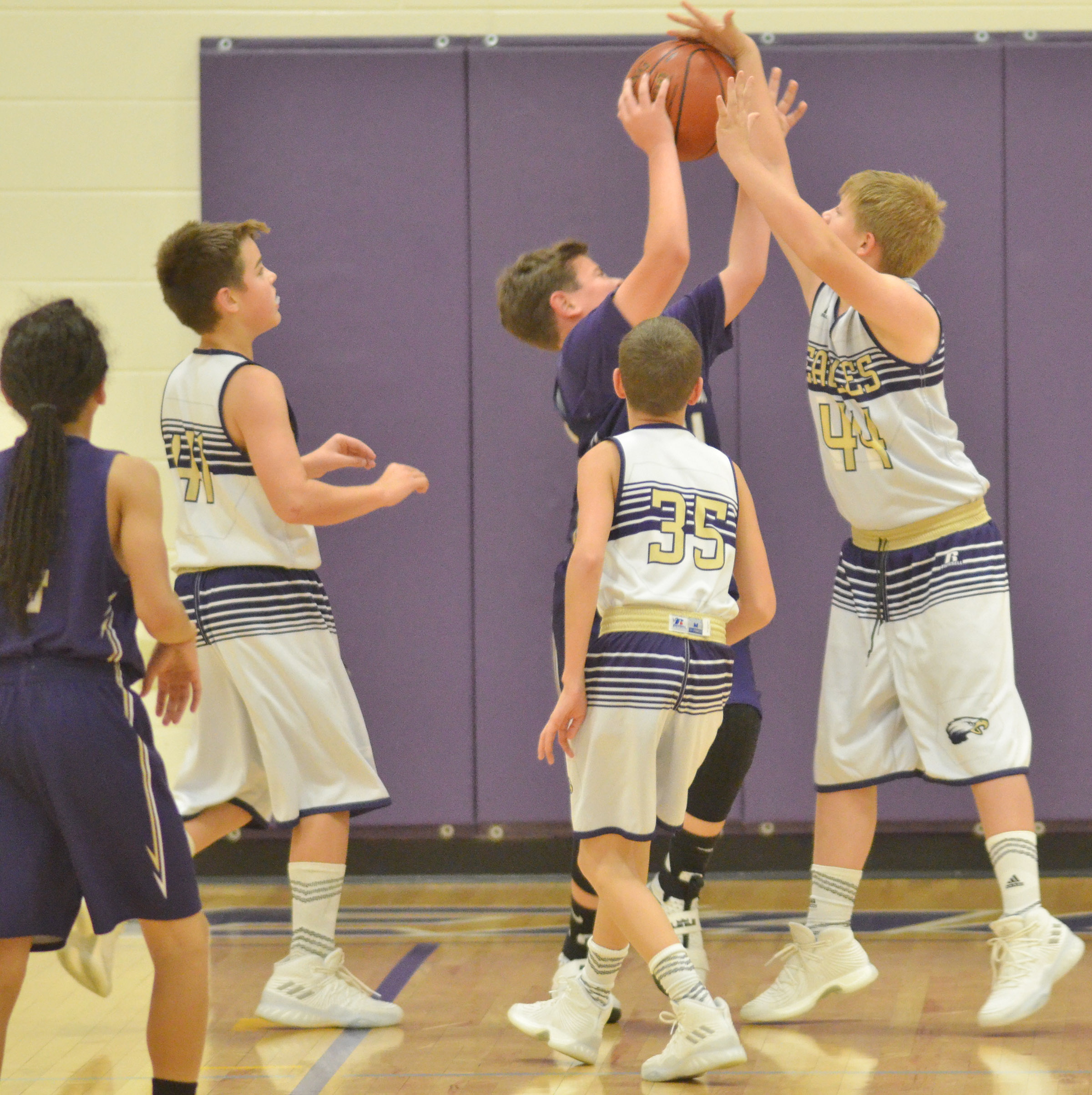 From left, CMS sixth-grader Kaden Bloyd, Campbellsville Elementary School fifth-grader Rowan Petett and sixth-grader Jesse King fight for the rebound.