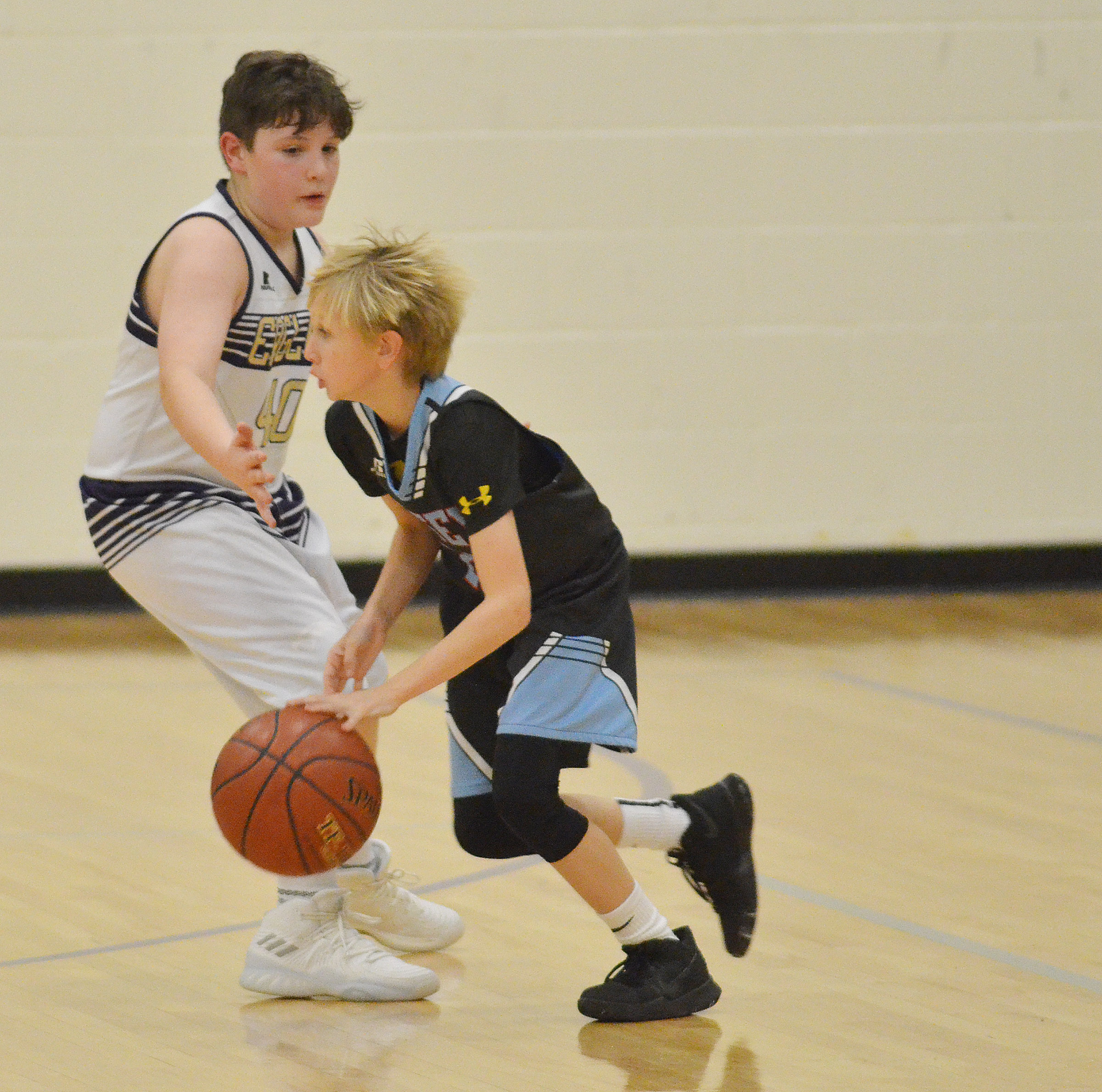 Campbellsville Elementary School fifth-grader Andrew Mardis plays defense.