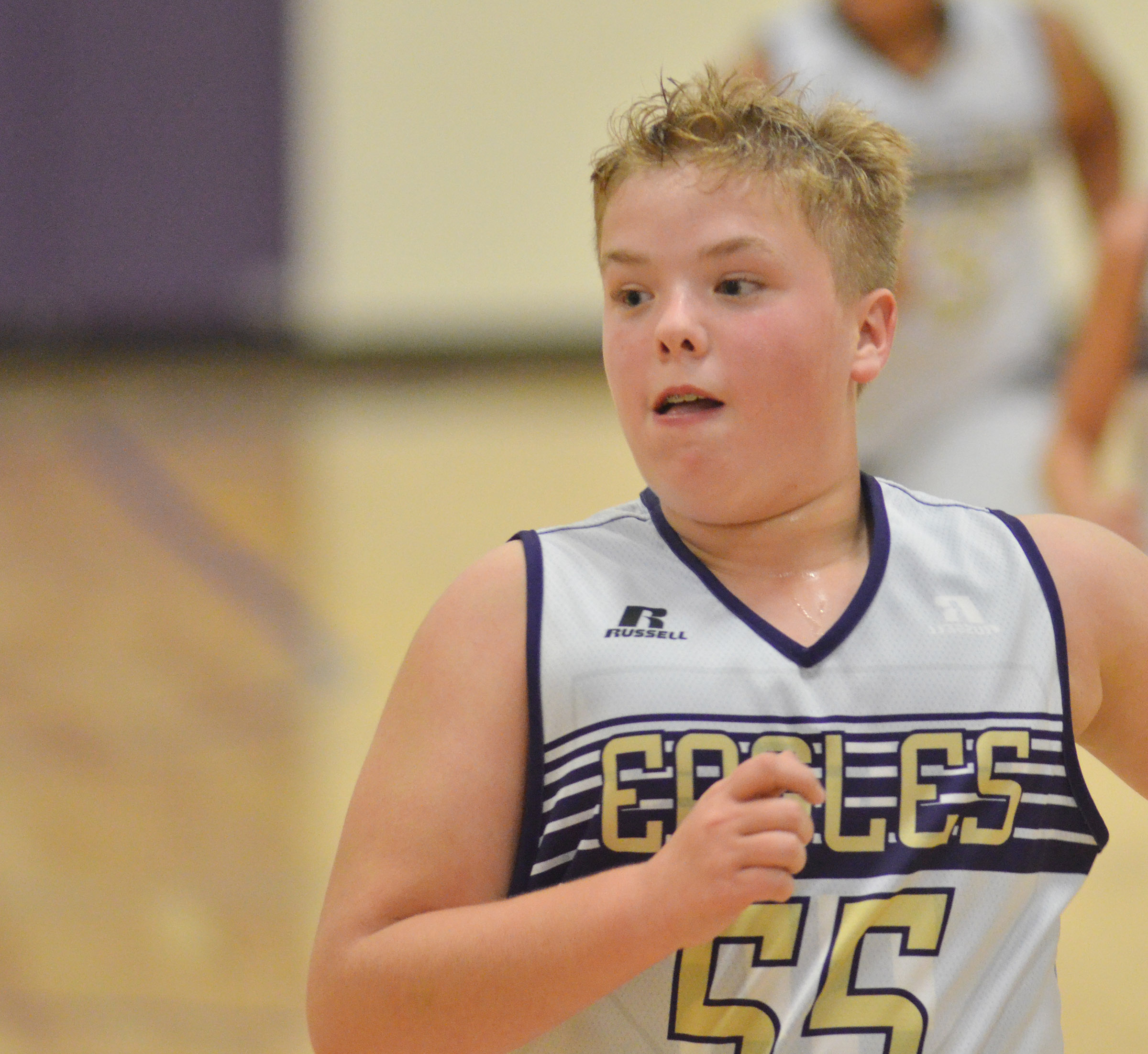 CMS sixth-grader Ryan Grubbs runs down the court.