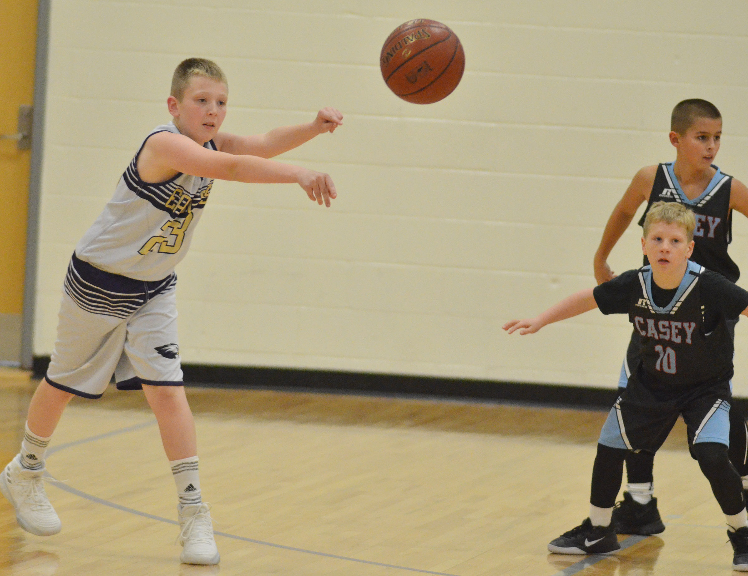 Campbellsville Elementary School fifth-grader Kaleb Miller passes the ball.