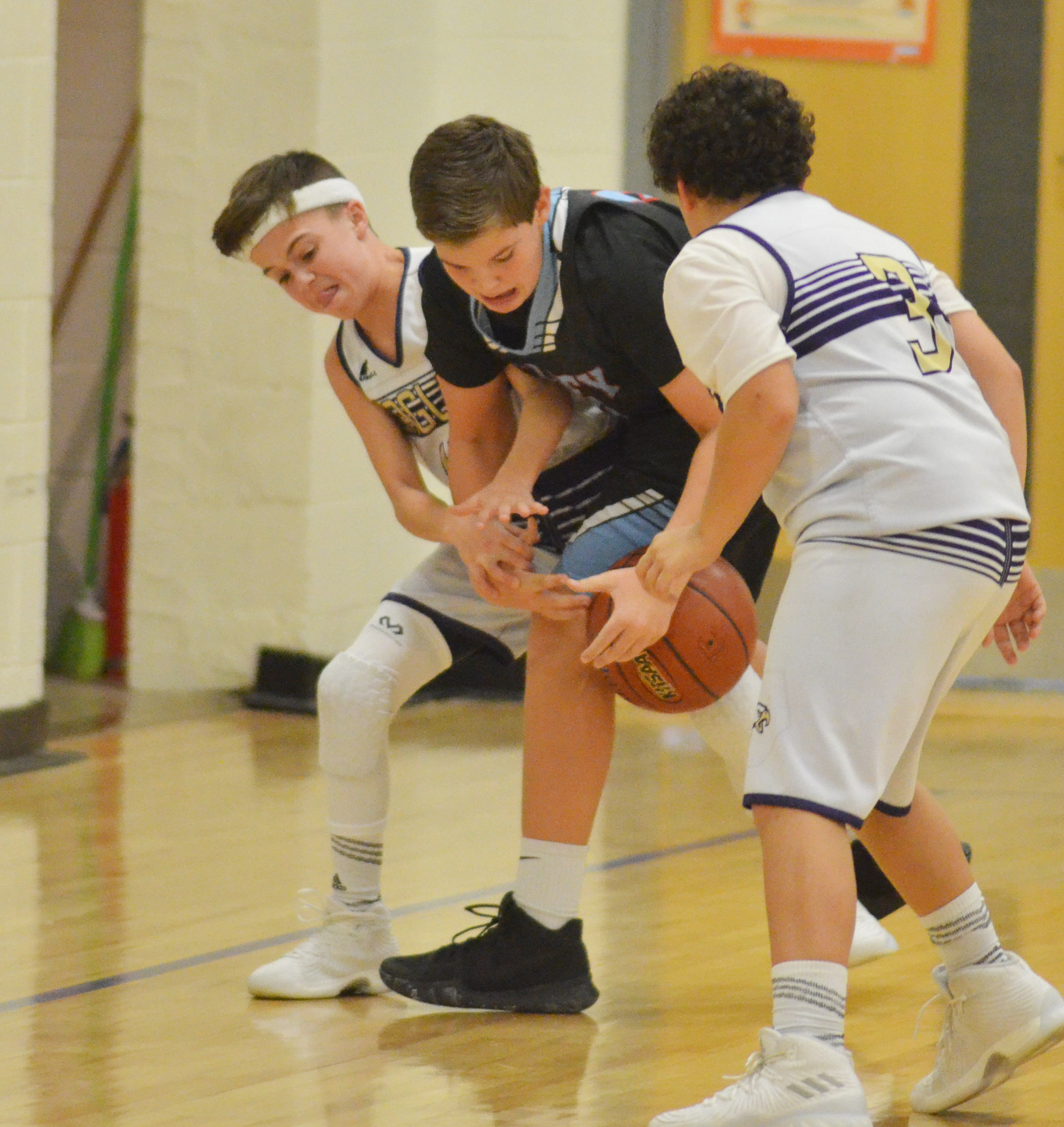 CMS seventh-graders Chase Hord, at left, and Kaydon Taylor fight for the ball.