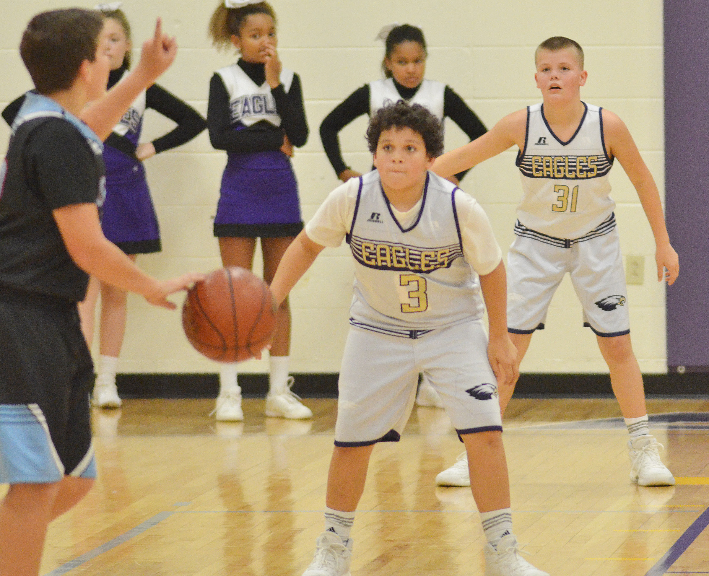 CMS seventh-graders Kaydon Taylor, at left, and Konner Forbis play defense.