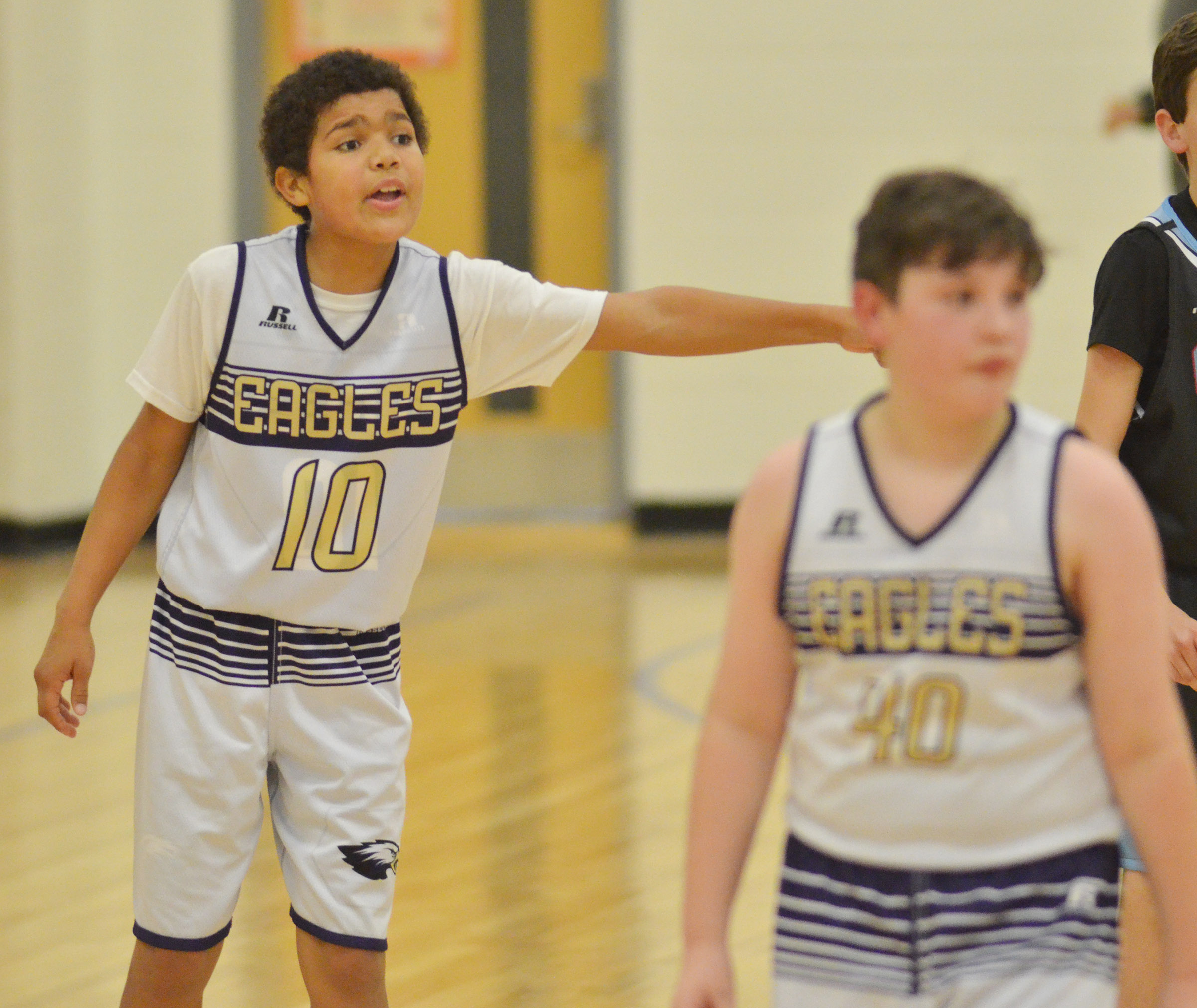 CMS sixth-grader Tashaun Hart talks to his teammates.