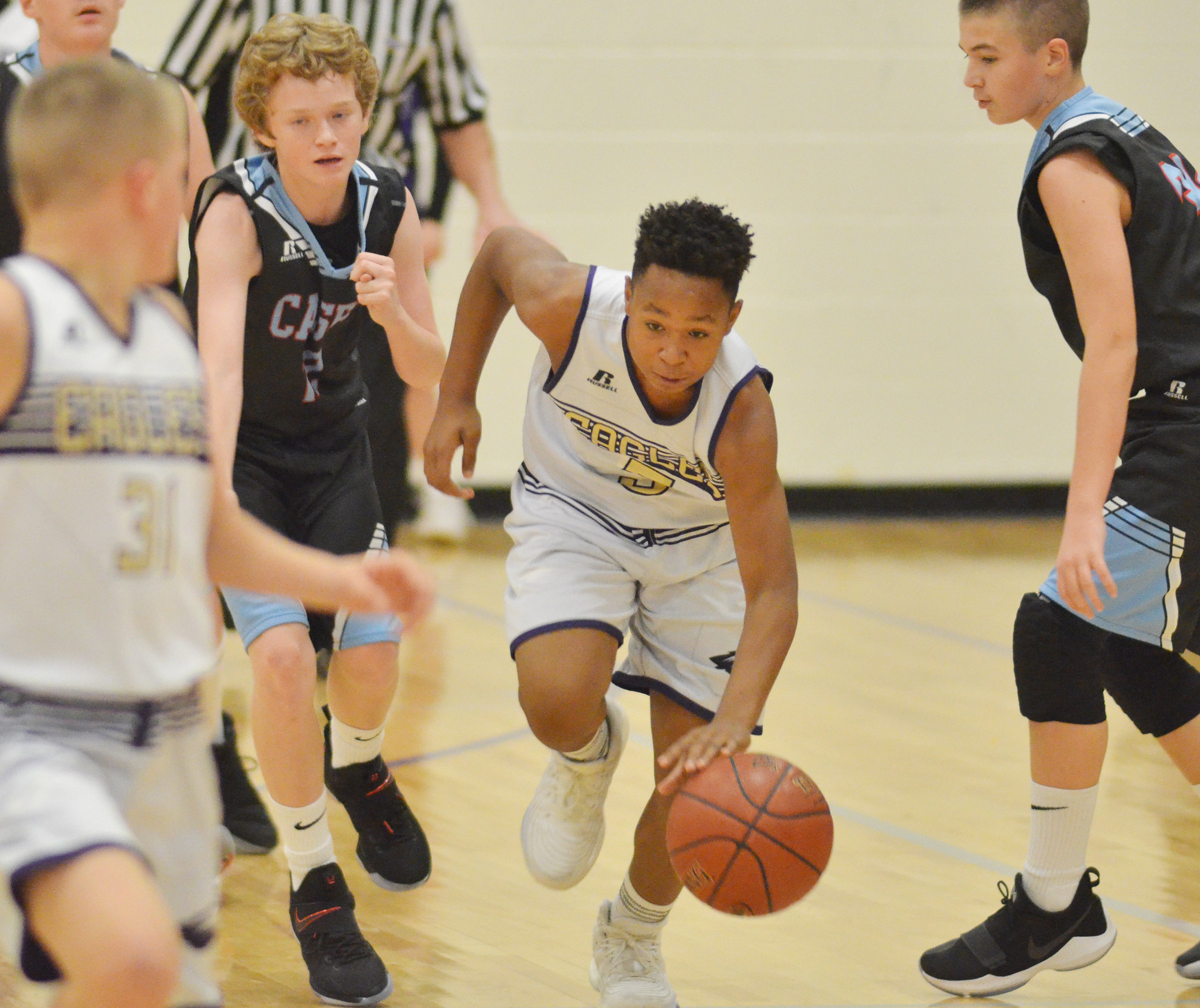 CMS seventh-grader Deondre Weathers dribbles.