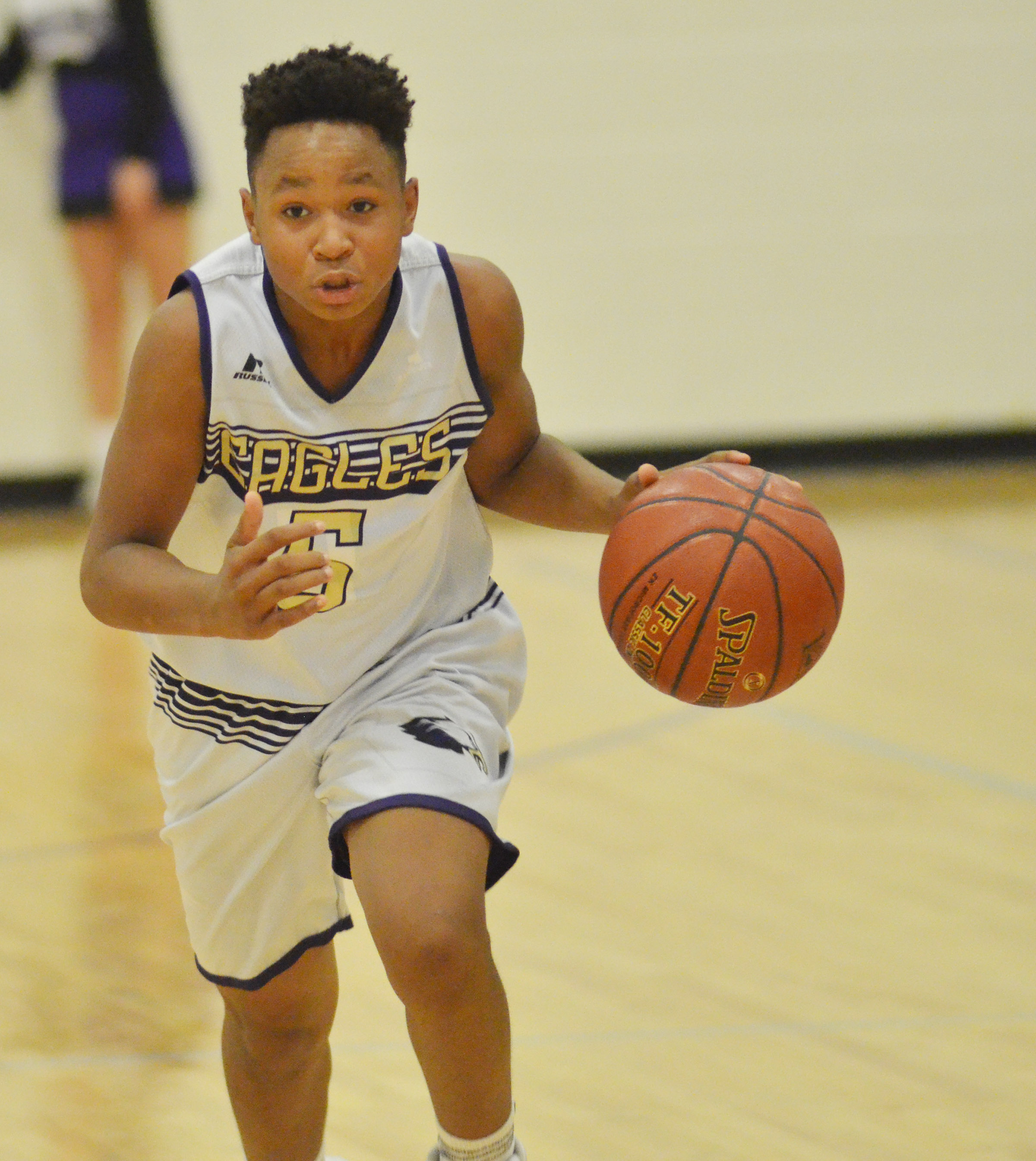 CMS seventh-grader Deondre Weathers dribbles to the basket.
