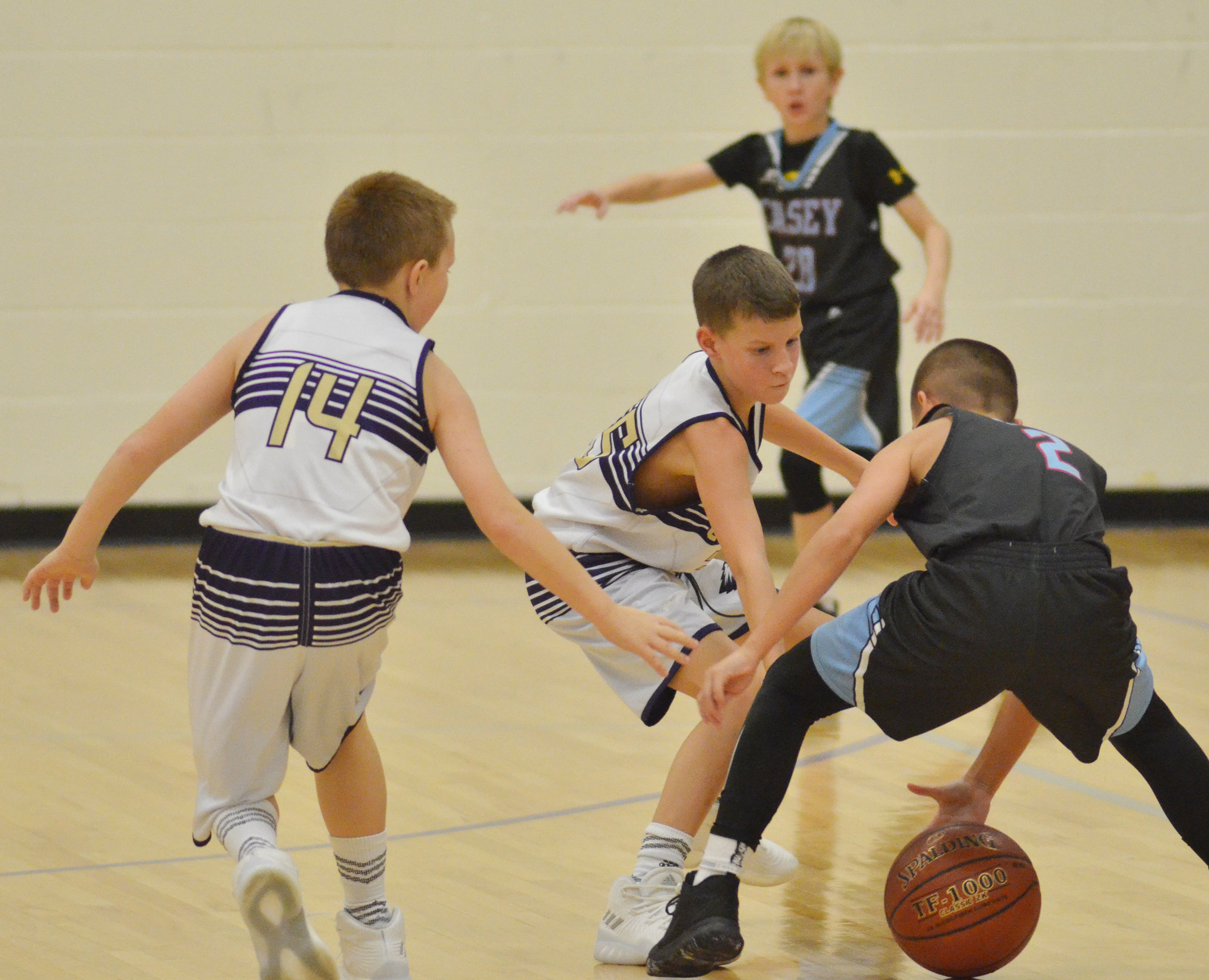 "CMS sixth-grader Jason ""Junior"" Jeffries, at left, and fifth-grader Rowan Petett play defense."