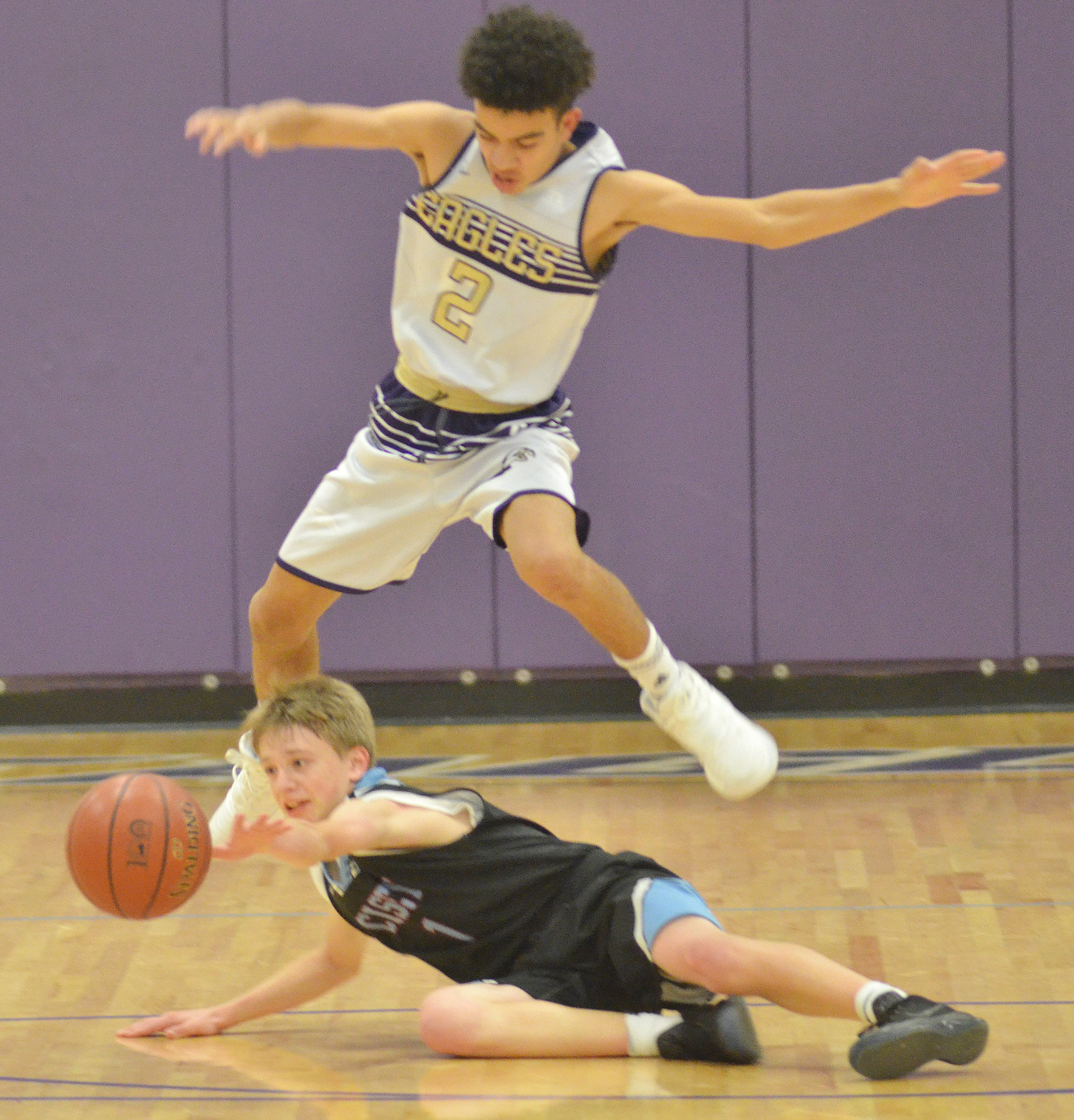 CMS eighth-grader Adrien Smith jumps over a Casey County player as they battle for the ball.