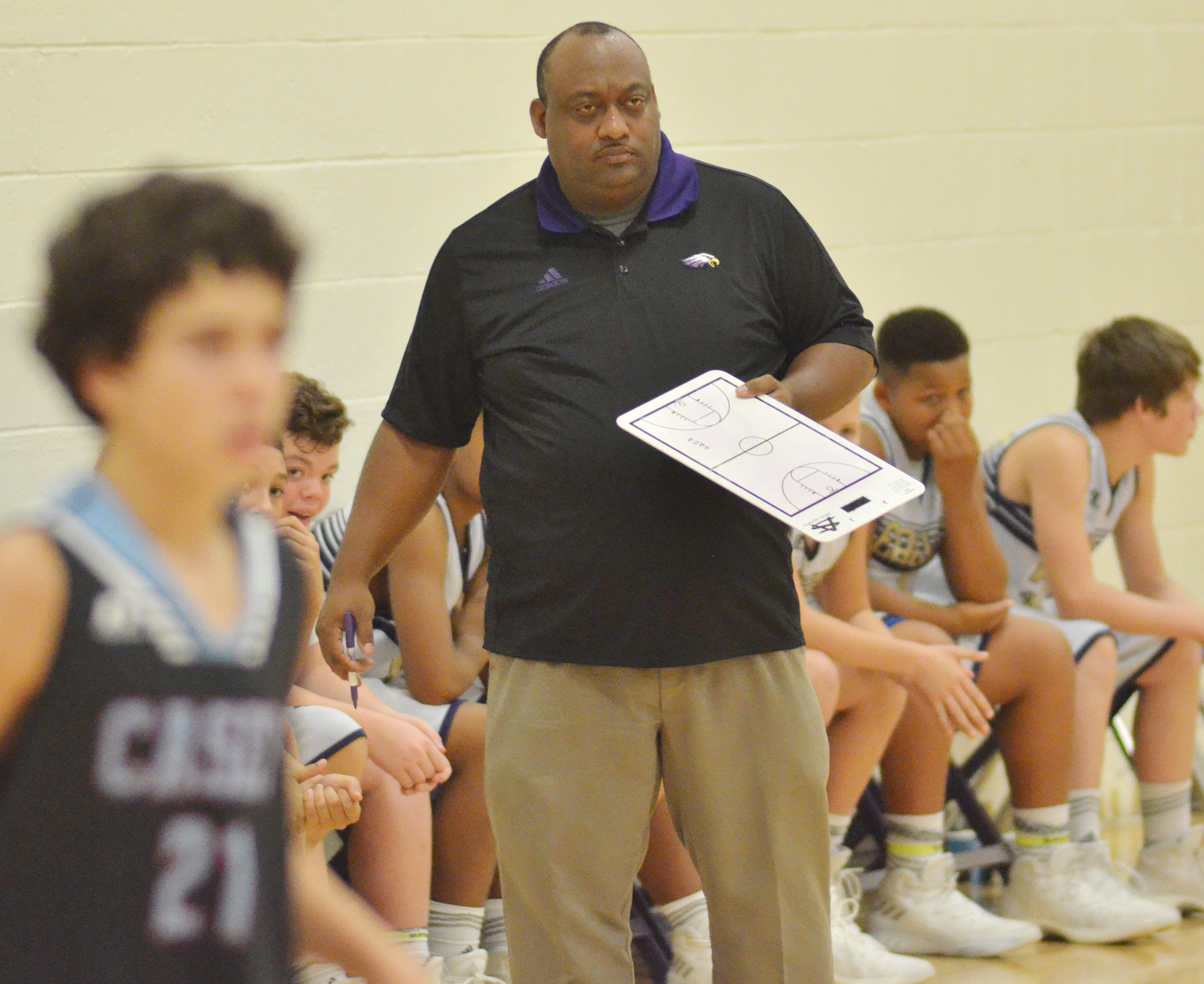 CMS head boys' basketball coach Joseph Taylor watches his players.