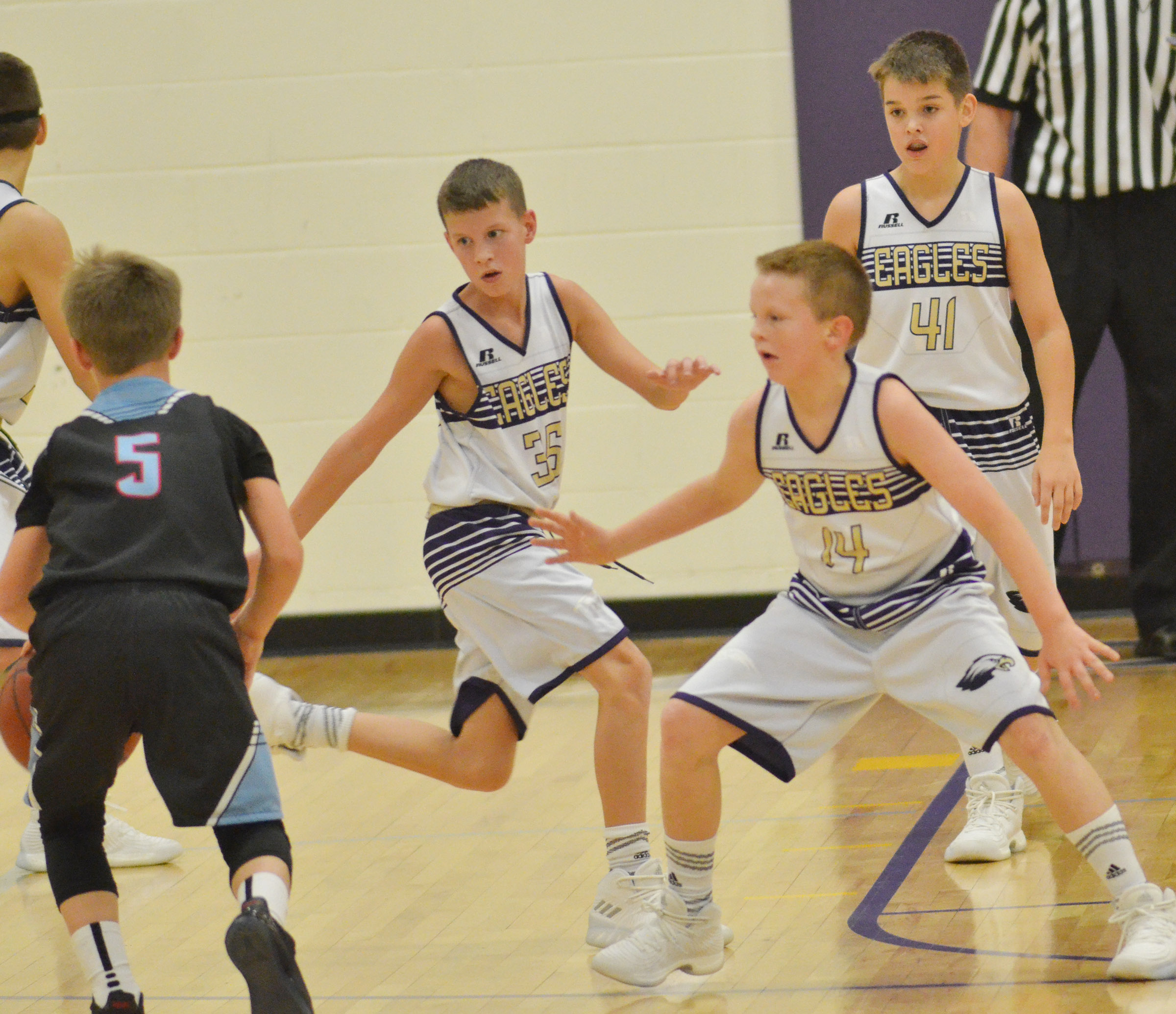 "From left, Campbellsville Elementary School fifth-grader Rowan Petett and CMS sixth-graders Jason ""Junior"" Jeffries and Kaden Bloyd play defense."