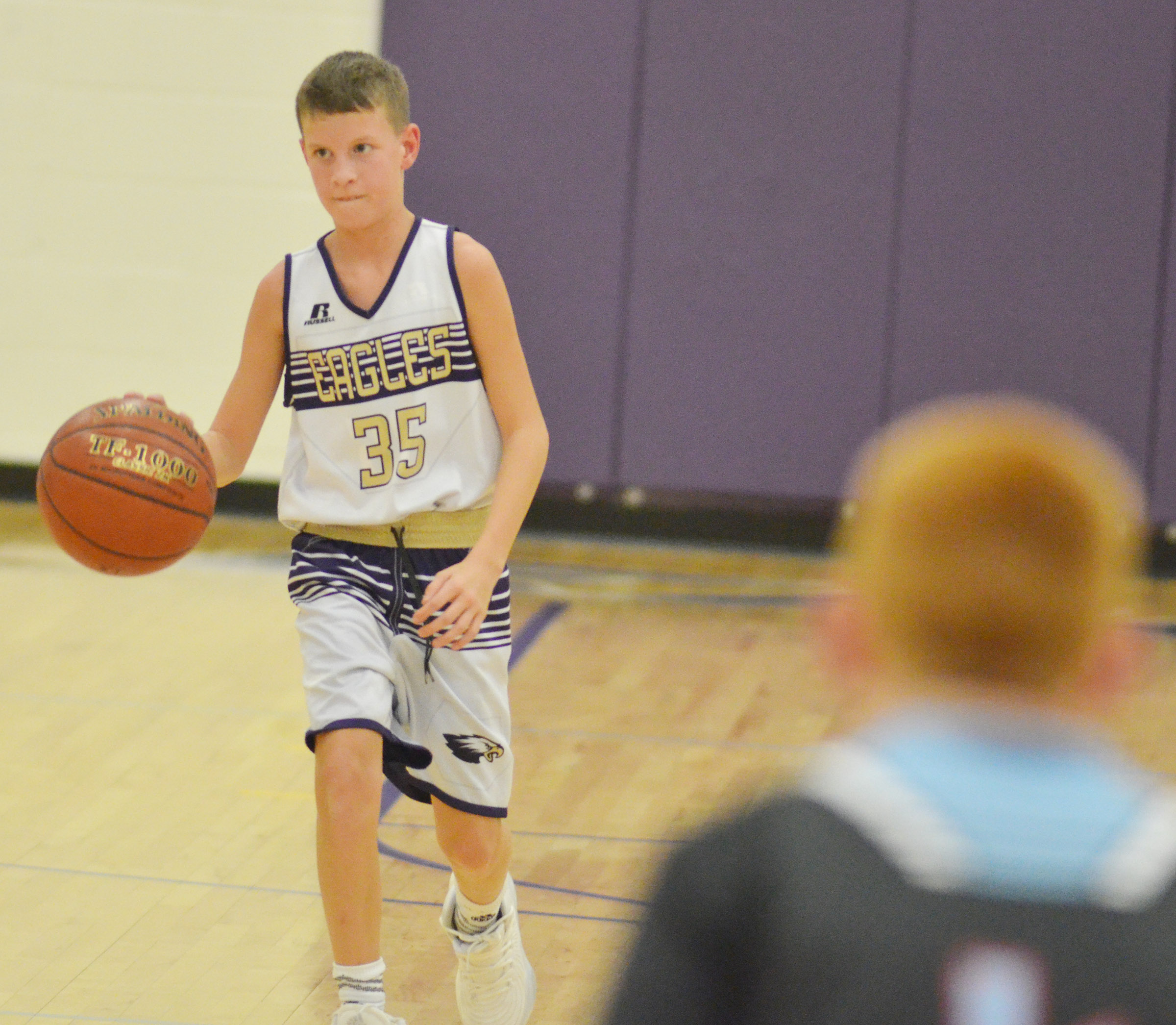 Campbellsville Elementary School fifth-grader Rowan Petett dribbles to the basket.