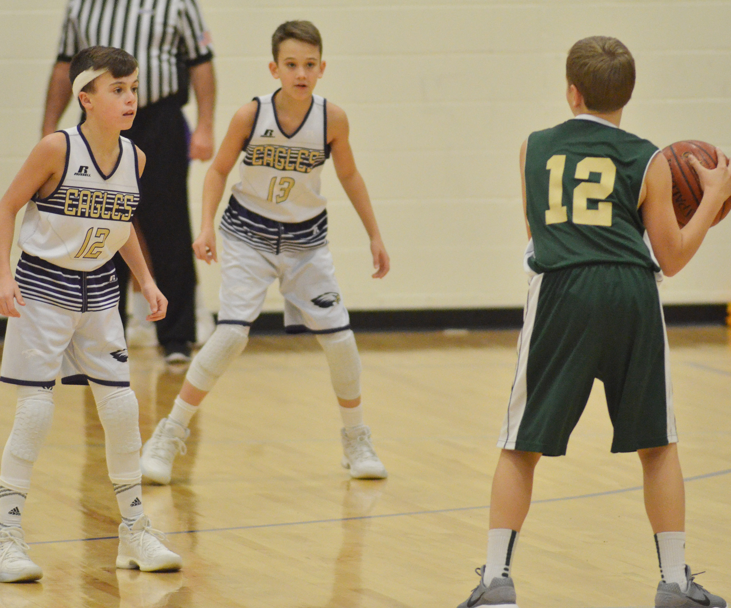 CMS seventh-graders Chase Hord, at left, and Camren Vicari play defense.