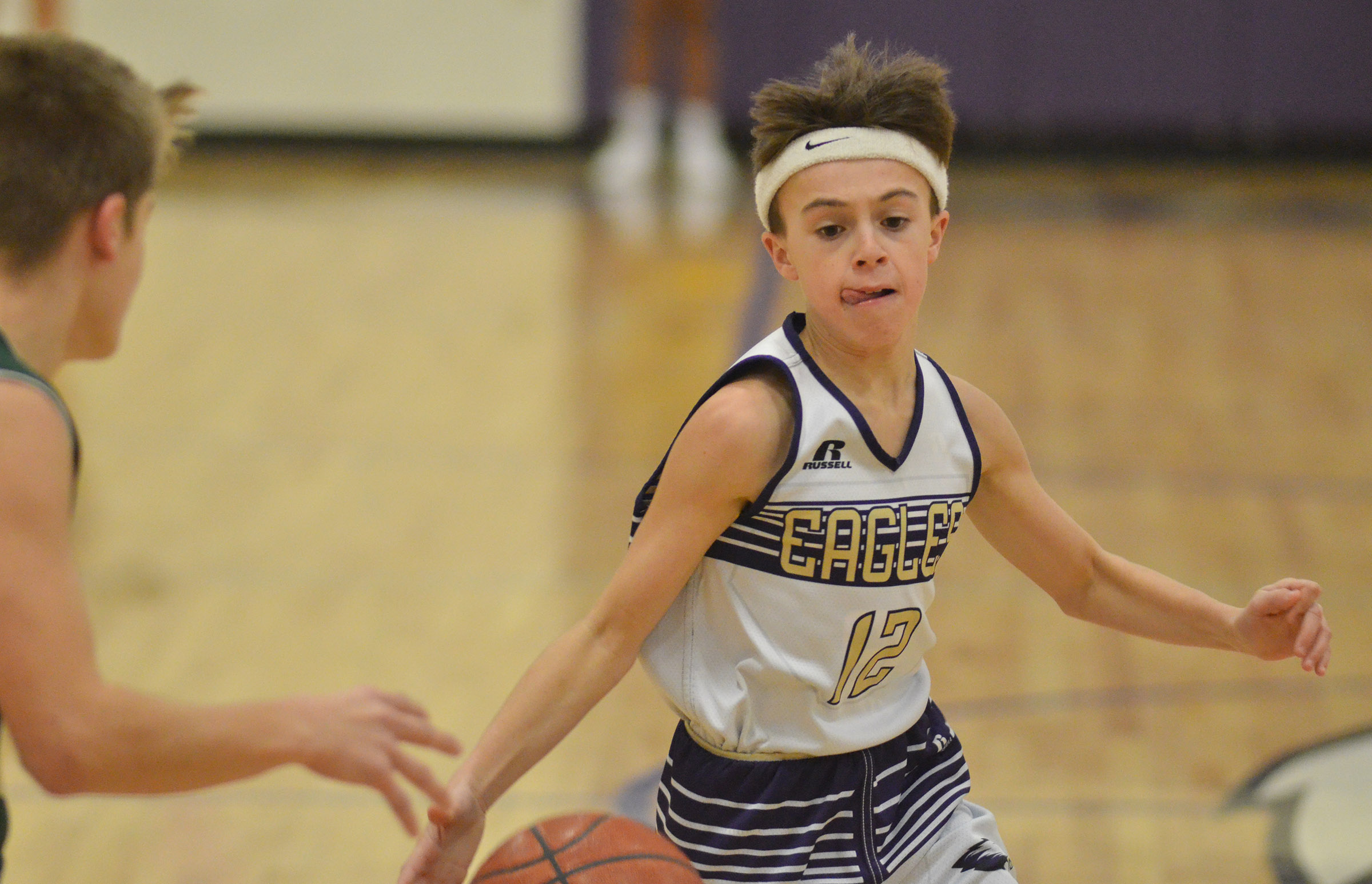 CMS seventh-grader Chase Hord dribbles to the basket.